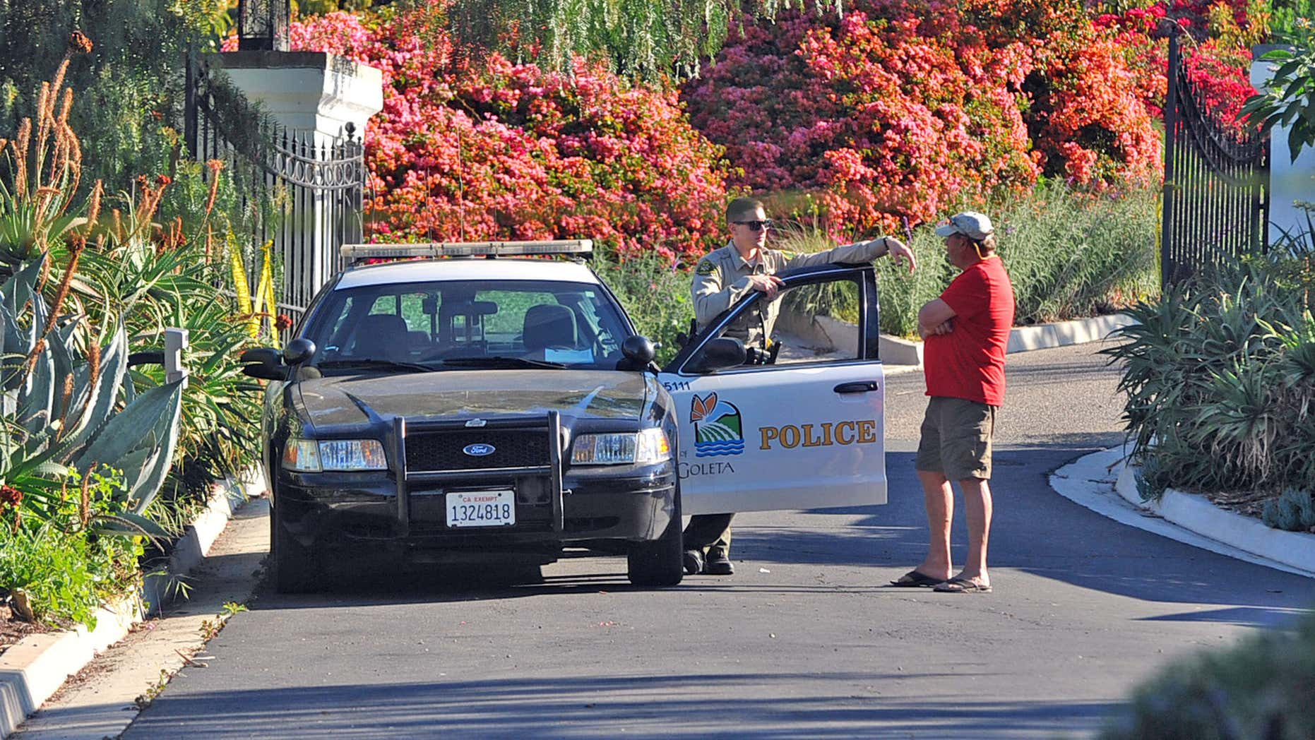 March 24, 2016: A Goleta Police officer stands guard near a home on Greenhill Way in unincorporated county territory between Santa Barbara and Goleta, Calif.