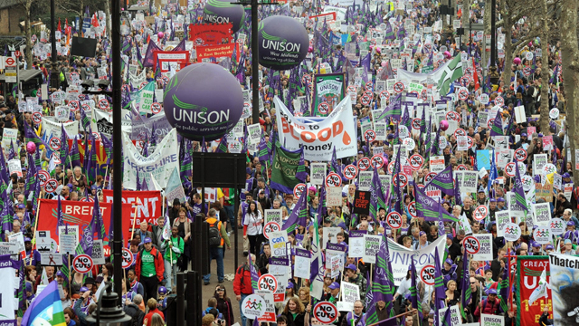 March 26: Demonstrators begin their march in London to protest against government spending cuts.