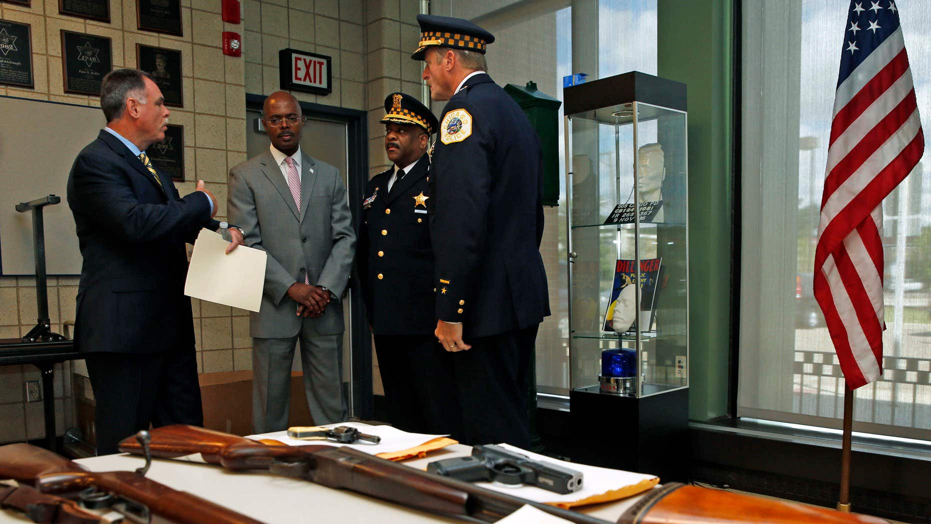 Sept. 3, 2013: Chicago Police Superintendent Garry McCarthy (L) speaks to First Deputy Superintendent Al Wysinger (2nd L), Deputy Chief of Area Central Patrol Eddie Johnson (2nd R) and Bureau of Patrol Chief Wayne Gulliford after a news conference on Chicago Police having seized more than 4,800 illegal firearms in 2013 in Chicago, Illinois,