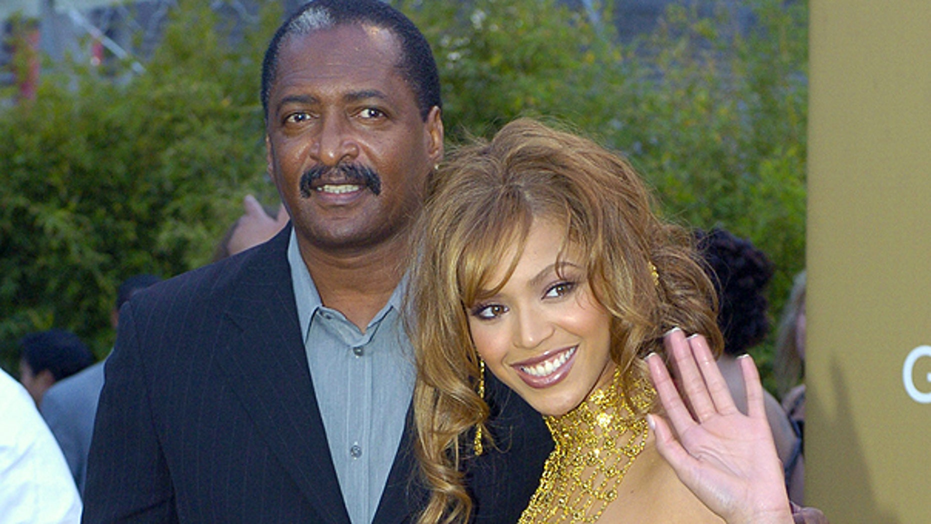 In this Feb. 8, 2004 file photo, singer Beyonce Knowles arrives at the 46th Annual Grammy Awards with her father and manager Mathew Knowles in Los Angeles.