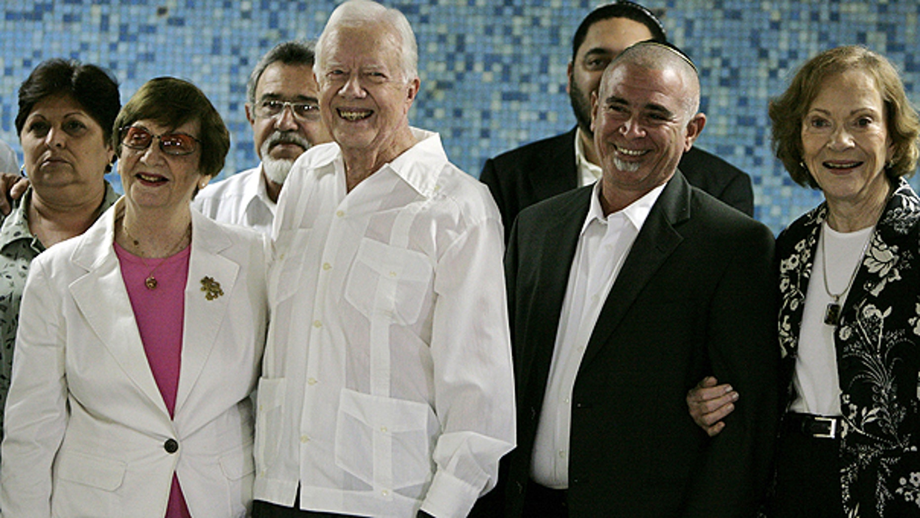 March 28: Authorities, front row, from left, Adela Dworin, President of the Cuban Jewish Community, former President Jimmy Carter, David Prinstein, Vice-President of the Cuban Jewish Community and Carter's wife Rosalynn Carter, pose for pictures during a visit to members of the Cuba Jewish Community in Havana, Cuba.