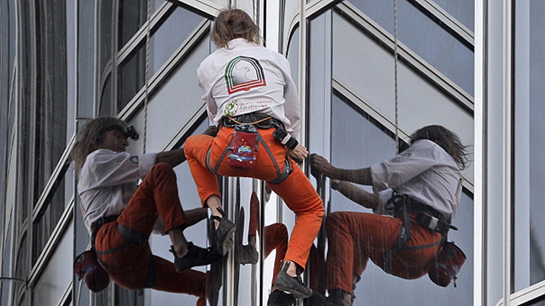March 28: French Spider man Alain Robert climbs up Burj Khalifa, the world's tallest tower in Dubai, United Arab Emirates.