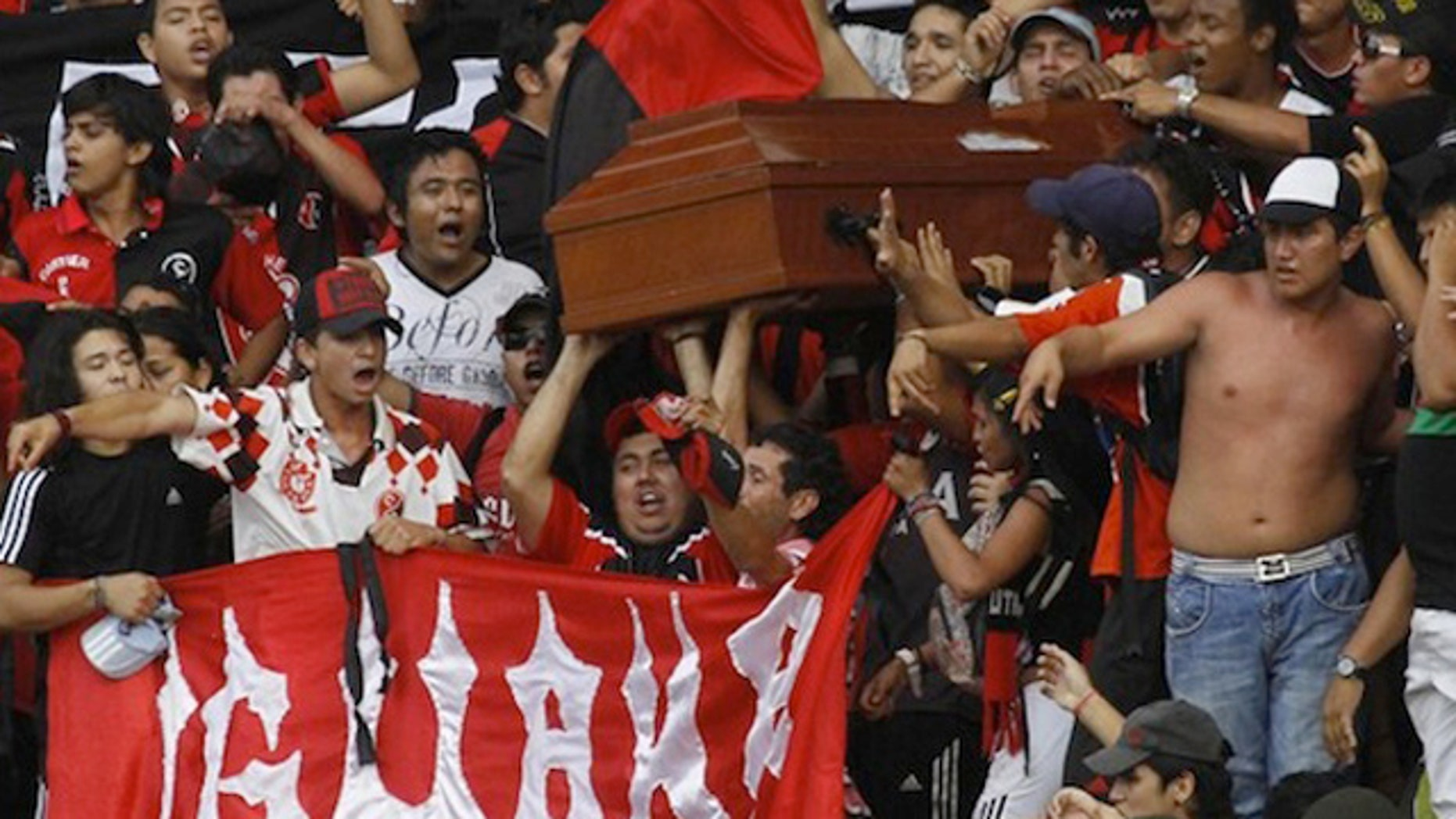 March 27: Supporters of Deportivo Cucuta football club carry a coffin as they arrive to the General Santander Stadium in Cucuta, Colombia.
