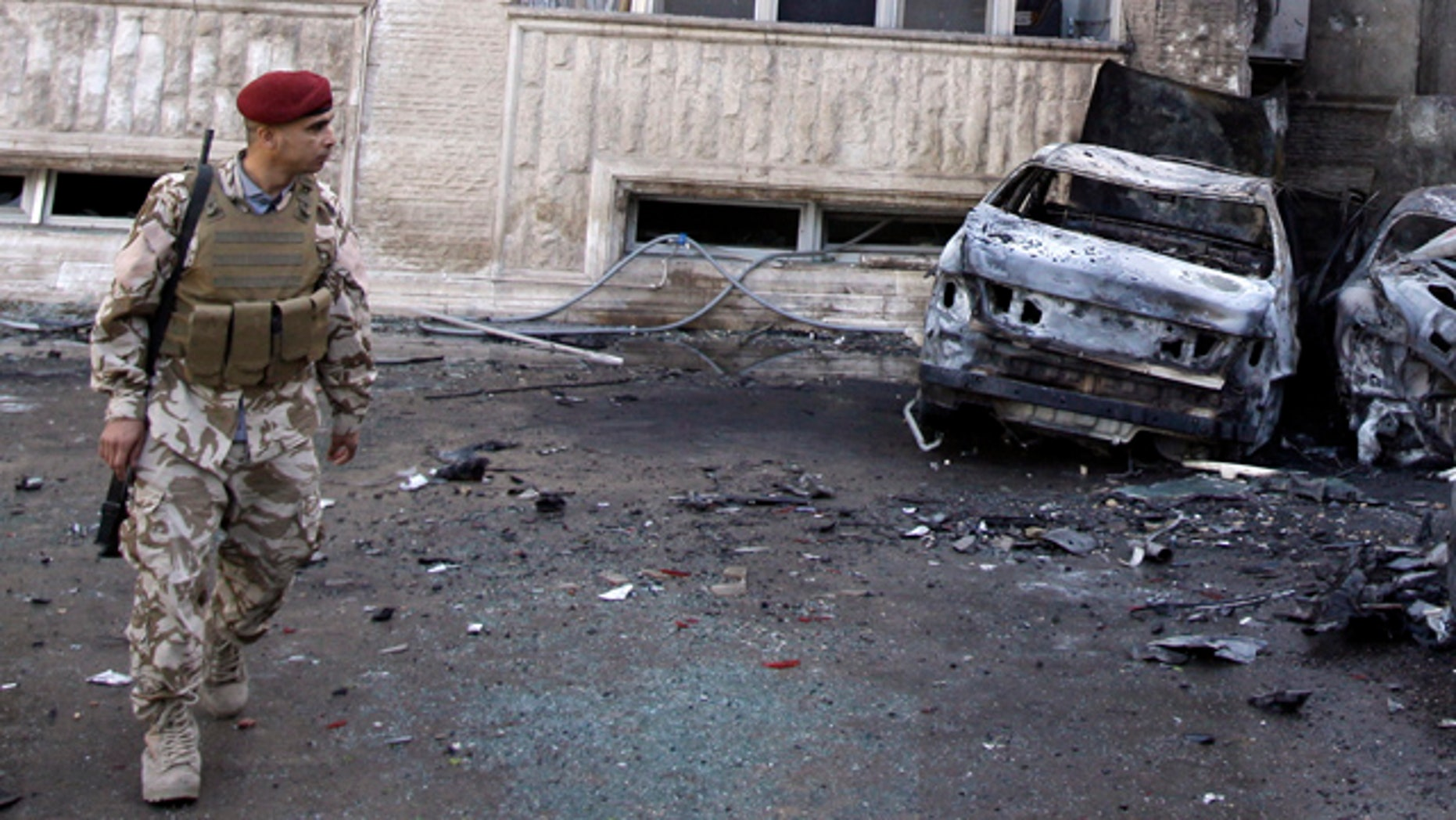 March 29: An Iraqi soldier inspects the scene of a rocket attack in Baghdad, Iraq.