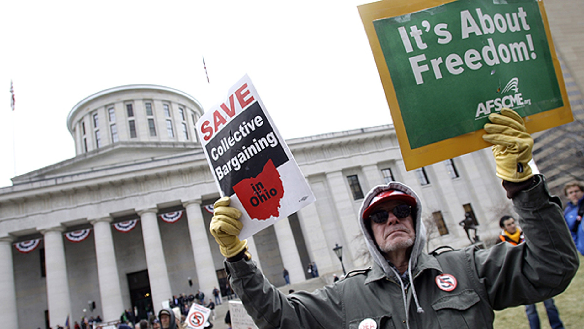 March 29: Tom Fagan, of Dayton, protests against Senate Bill 5 at the Ohio statehouse in Columbus, Ohio.