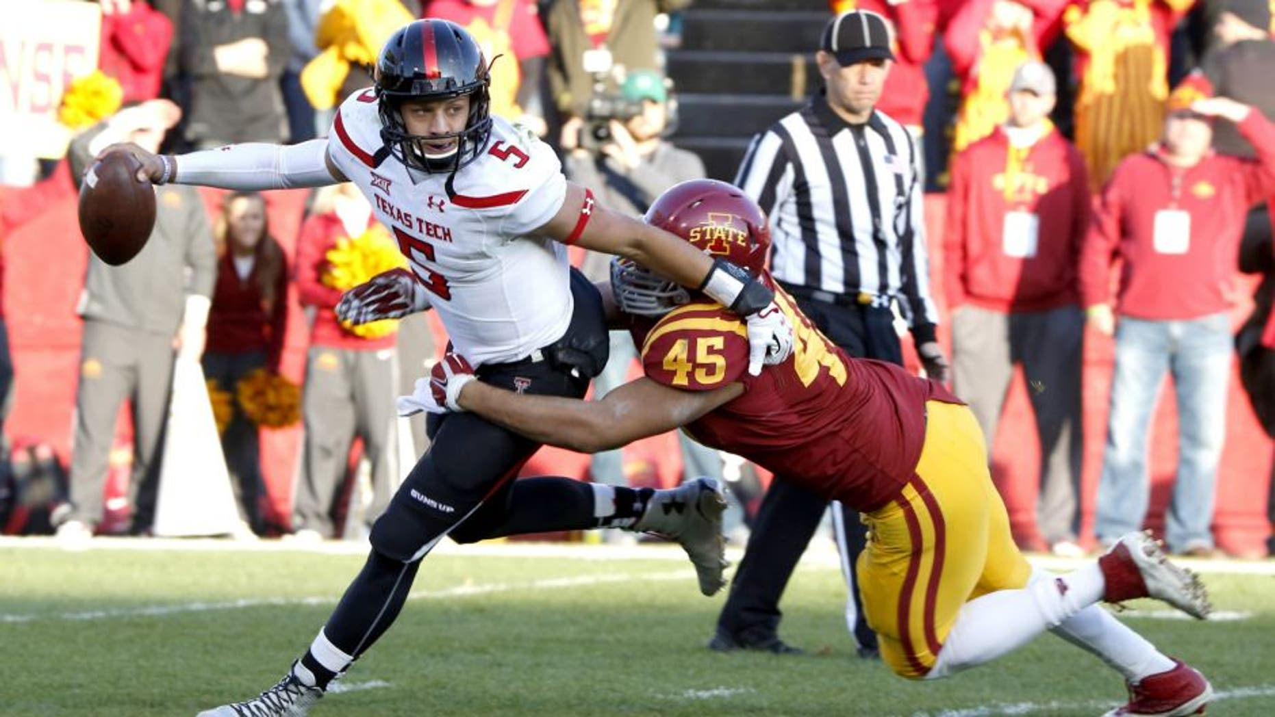 AMES, IA - NOVEMBER 22: Quarterback Patrick Mahomes #5 of the Texas Tech Red Raiders is tackled by defensive end Dale Pierson #45 of the Iowa State Cyclones in the first half of play at Jack Trice Stadium on November 22, 2014 in Ames, Iowa. (Photo by David K Purdy/Getty Images)