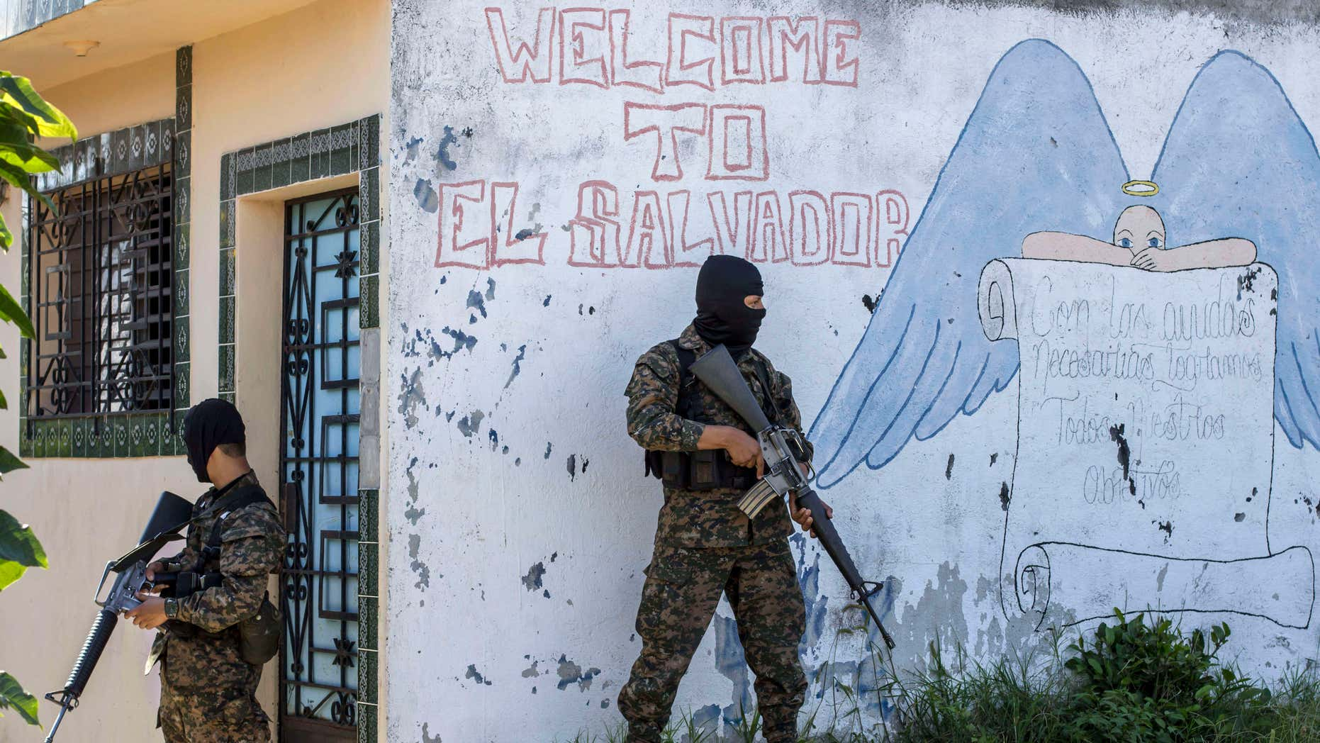 FILE - In this Aug. 31, 2015 file photo, soldiers guard a corner in a gang-controlled neighborhood in Ilopango, El Salvador.
