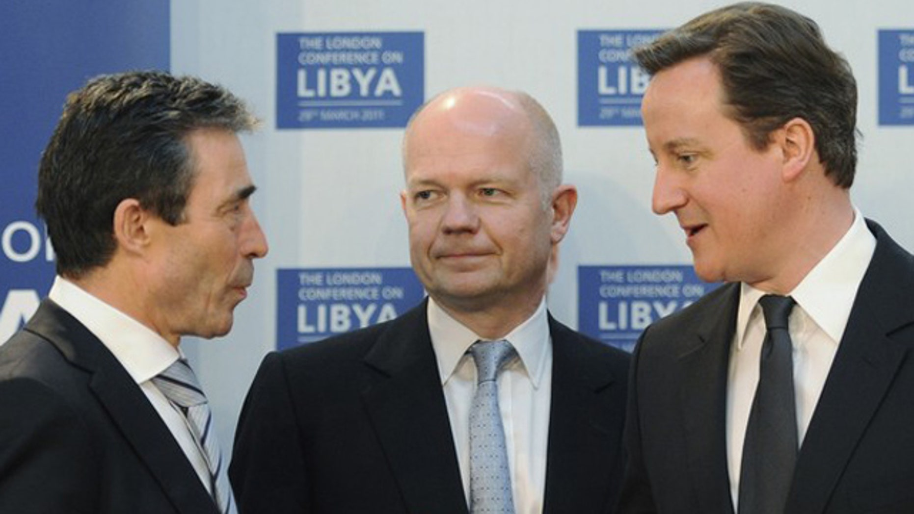 March 29: Britain's Prime Minister David Cameron (R) speaks to NATO Secretary General Anders Fogh Rasmussen (L), watched by Foreign Secretary William Hague, at the Foreign & Commonwealth Office in London.