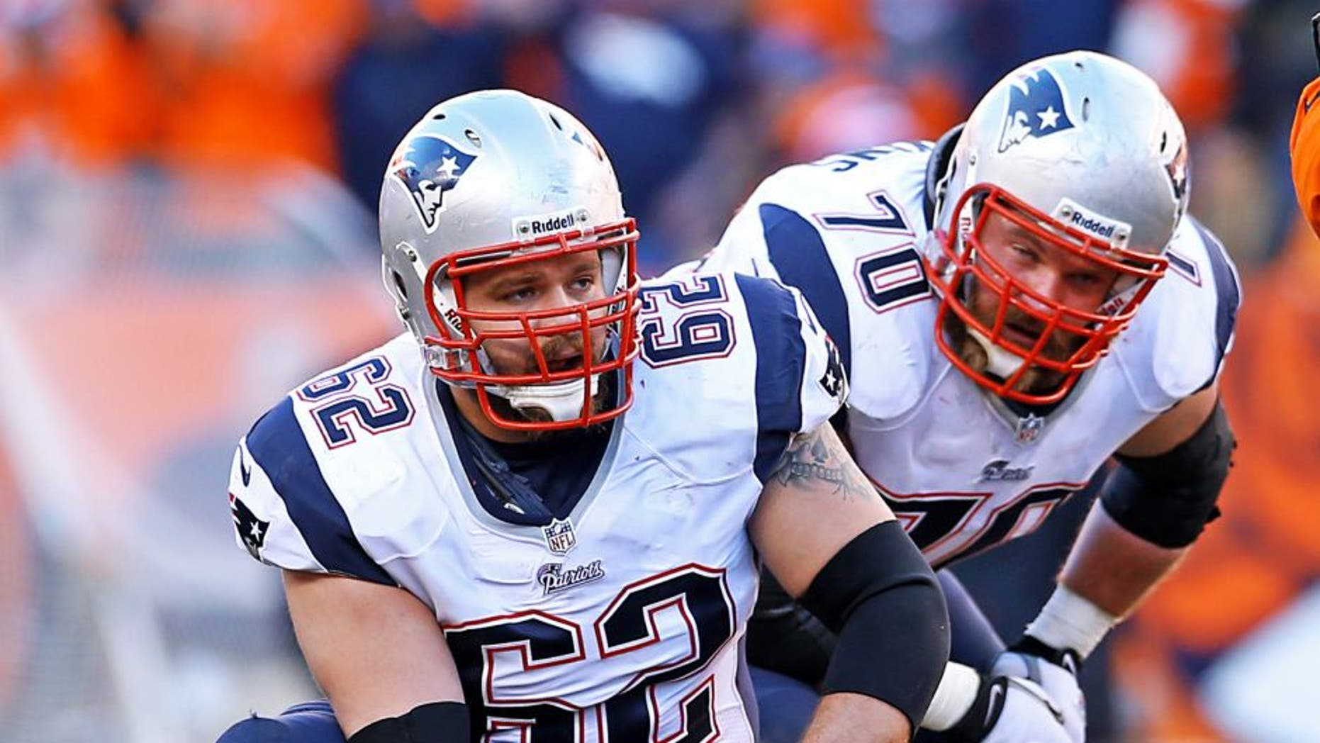 January 19, 2014; Denver, CO, USA; New England Patriots offensive lineman Ryan Wendell (62) and guard Logan Mankins (70) against the Denver Broncos in the 2013 AFC Championship football game at Sports Authority Field at Mile High. Mandatory Credit: Mark J. Rebilas-USA TODAY Sports