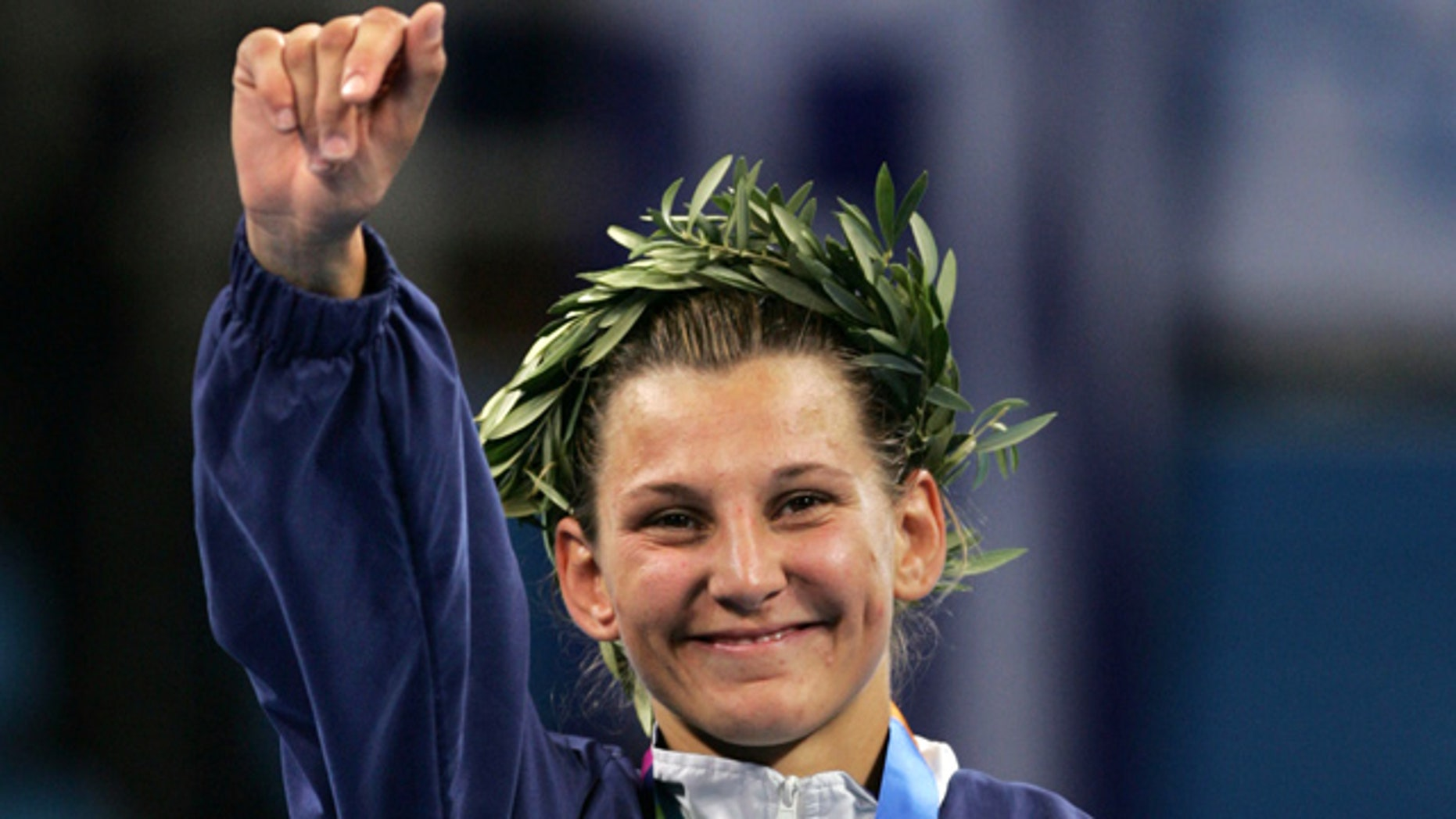 In this Aug. 17, 2004, file photo, silver medalist Claudia Heill of Austria waves to the crowd after the women's judo half-middle weight (-63kg) event at the 2004 Olympic Games in Athens.