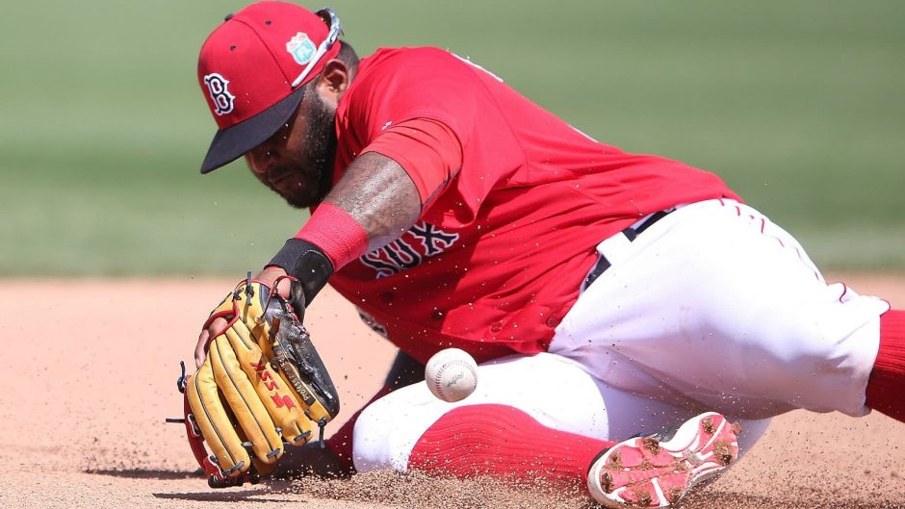 FORT MYERS, - MARCH 14: Pablo Sandoval #48 of the Boston Red Sox knocks the ball down at third base on the ground ball from Jason Rogers (not in photo) of the Pittsburgh Pirates an makes the play to first base for the out during the fourth inning of the Spring Training Game on March 14, 2016 at Jet Blue Park at Fenway South, Florida. The Pirates defeated the Red Sox 3-1. (Photo by Leon Halip/Getty Images)