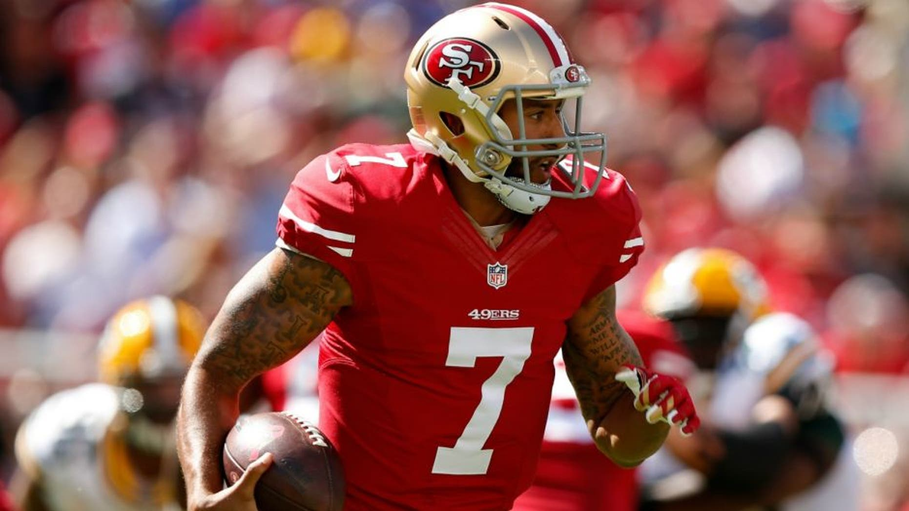 during their NFL game at Levi's Stadium on October 4, 2015 in Santa Clara, California.,SANTA CLARA, CA - OCTOBER 04: Quarterback Colin Kaepernick #7 of the San Francisco 49ers runs with the ball against the Green Bay Packers during their NFL game at Levi's Stadium on October 4, 2015 in Santa Clara, California. (Photo by Ezra Shaw/Getty Images)