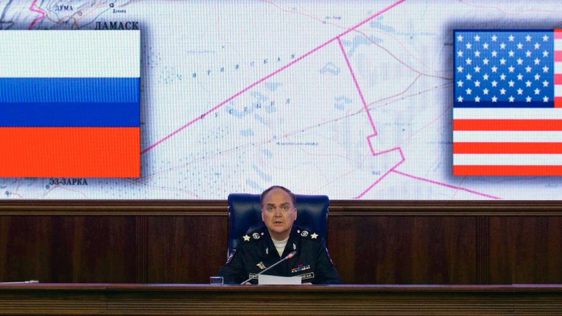 FILE - In this file photo dated Friday, Oct. 7, 2016, Russian Deputy Defense Minister Anatoly Antonov speaks during a media briefing in the Defense Ministry in Moscow.  While Western media are filled with grim images of life in areas of Aleppo under siege by Russian-backed Syrian government forces, Russian news reports tell a very different story. (AP Photo/Ivan Sekretarev, File)
