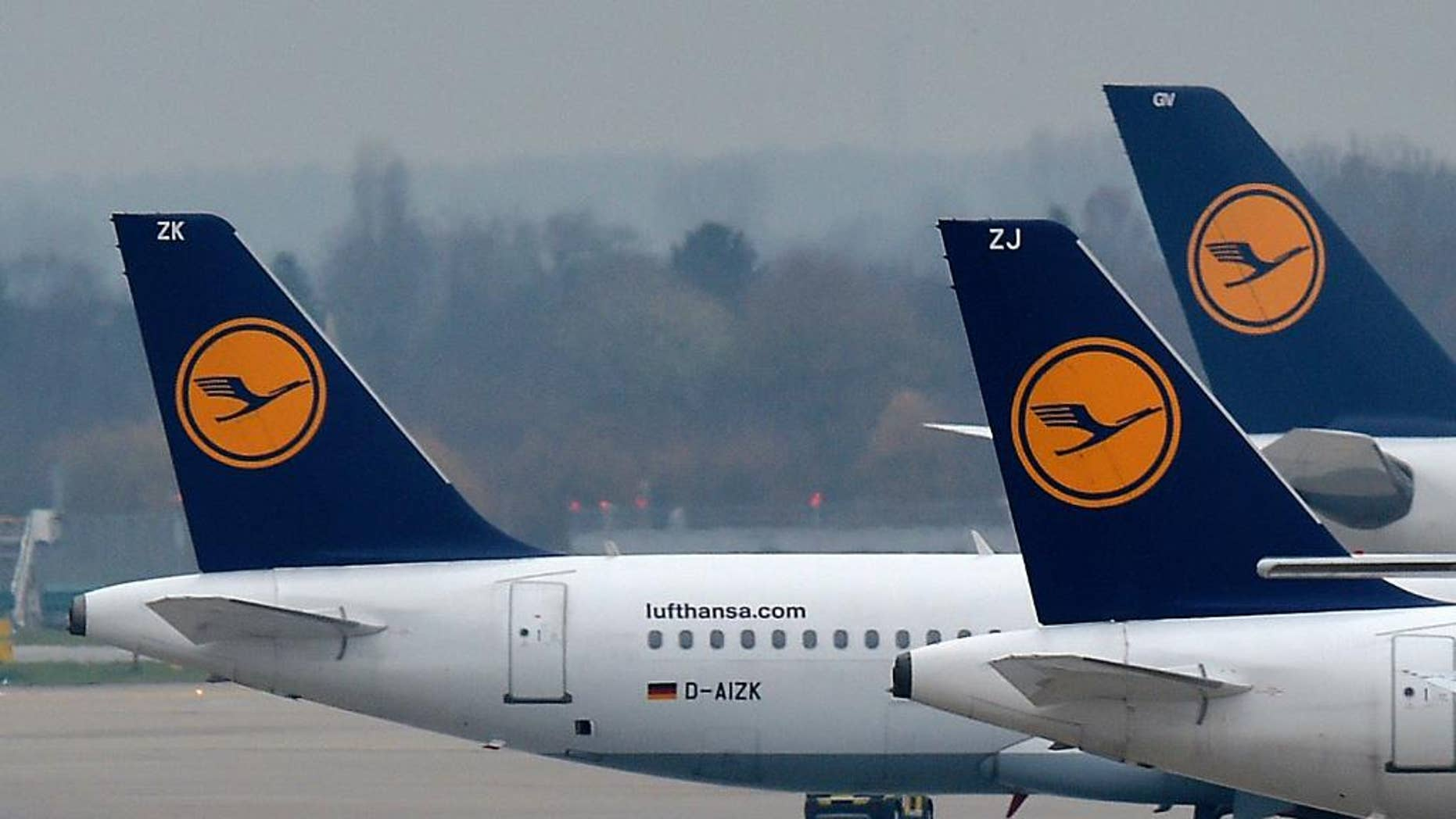FILE - In this Dec. 1, 2014 file photo Lufthansa planes are parked at the airport in Duesseldorf, Germany. Lufthansa and their pilots found an agreement over all their rate disputes. (AP Photo/Martin Meissner, File)