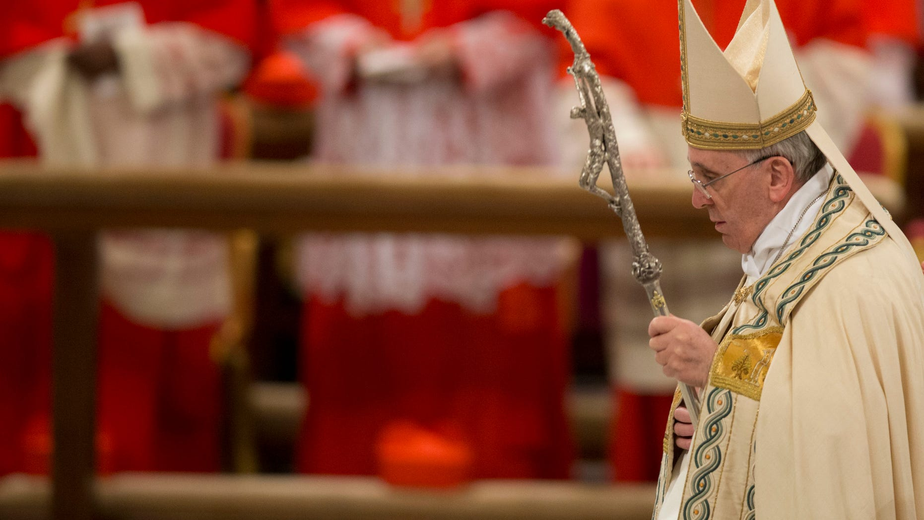Pope Francis arrives to preside over a Vespers ceremony at Rome's St. Paul Basilica, at the Vatican, Saturday, Jan. 25, 2014. (AP Photo/Andrew Medichini)