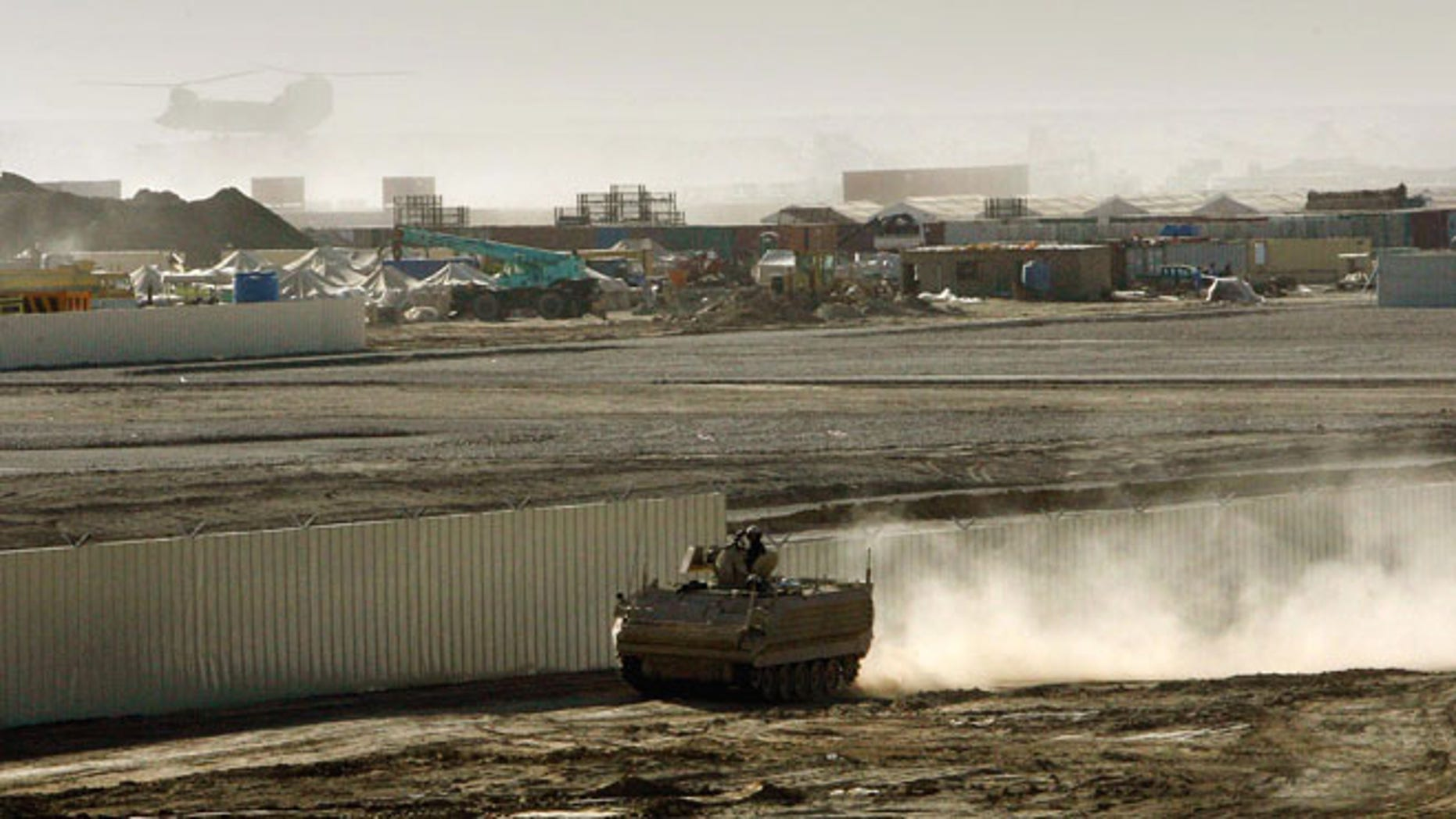 An armored vehicle patrols on the periphery of Camp Bastion in southern Afghanistan, in this Wednesday, Jan. 10, 2007 file photo.