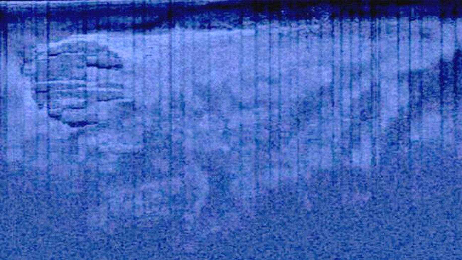 """Team Ocean Explorer said this image shows 300m """"drag marks"""" around an unidentified -- possibly flying -- object."""