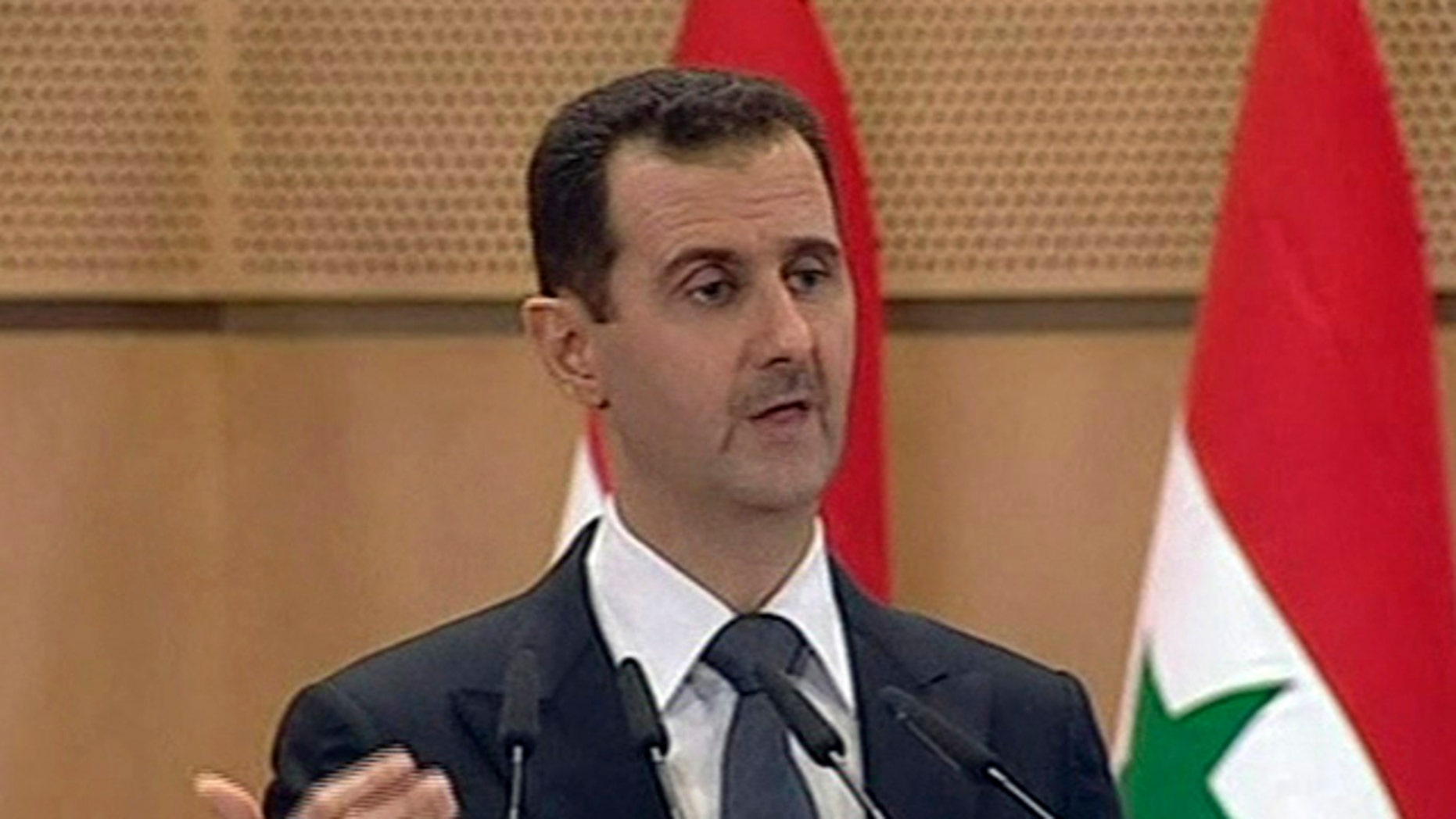 June 20: In this screen grab taken from Syrian TV, Syria's President, Bashar Assad delivers a speech in Damascus.