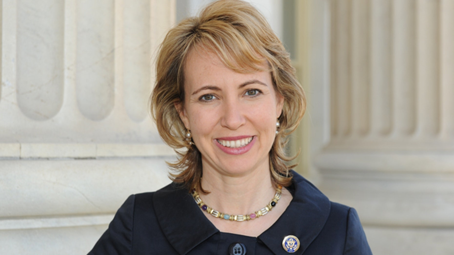 Rep. Gabrielle Giffords stood up in her hospital room Wednesday and looked out her window