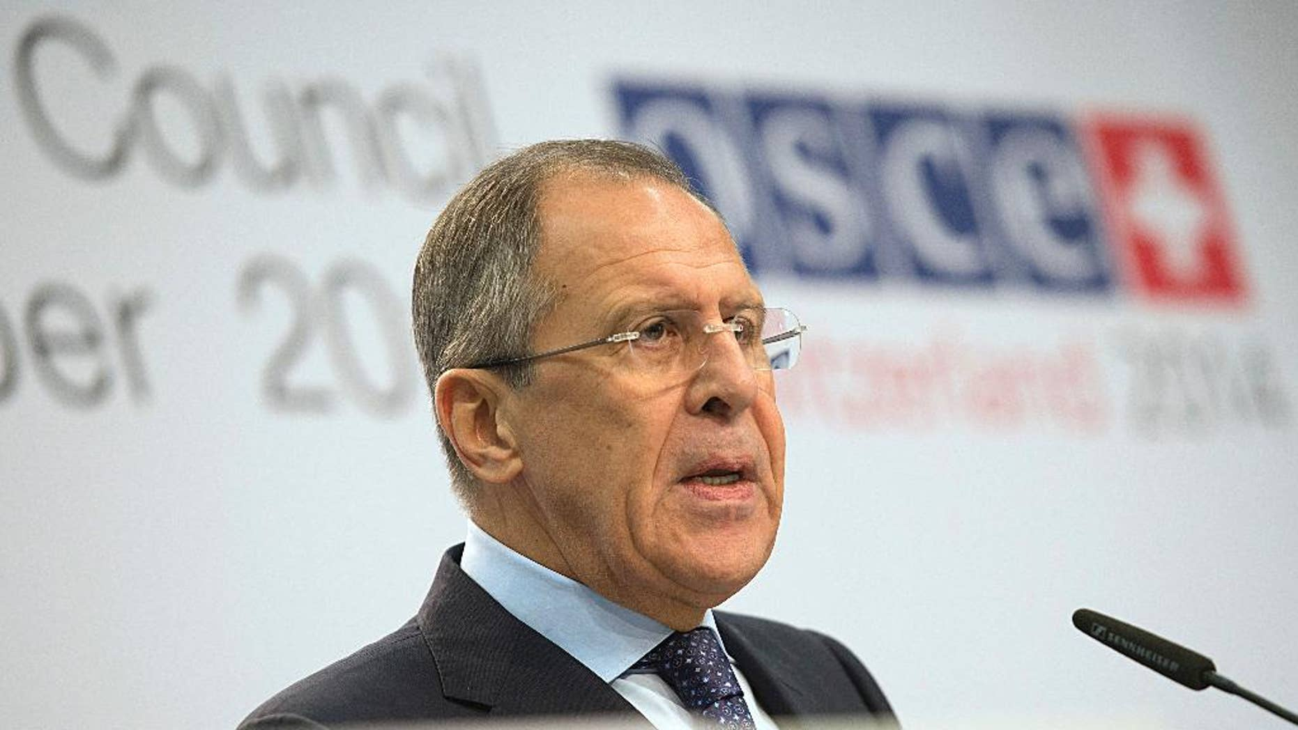 Russia's  foreign minister Sergey Lavrov,  speaks during a  news  conference at the   Organization for Security and Cooperation in Europe (OSCE) ministerial meeting in the Exhibition Center in Basel, Switzerland, on Friday, Dec.  5 2014. (AP Photo/Keystone,Georgios Kefalas)