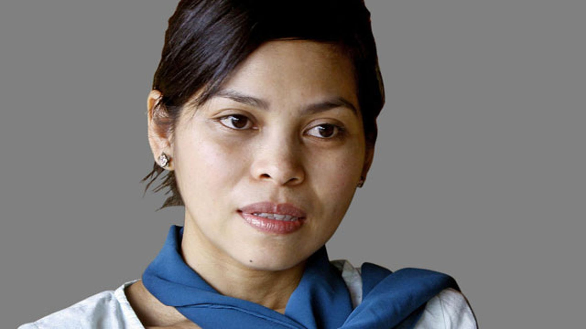 Muslim model, Kartika Sari Dewi Shukarno, who faced caning for drinking beer in Karai, Malaysia.