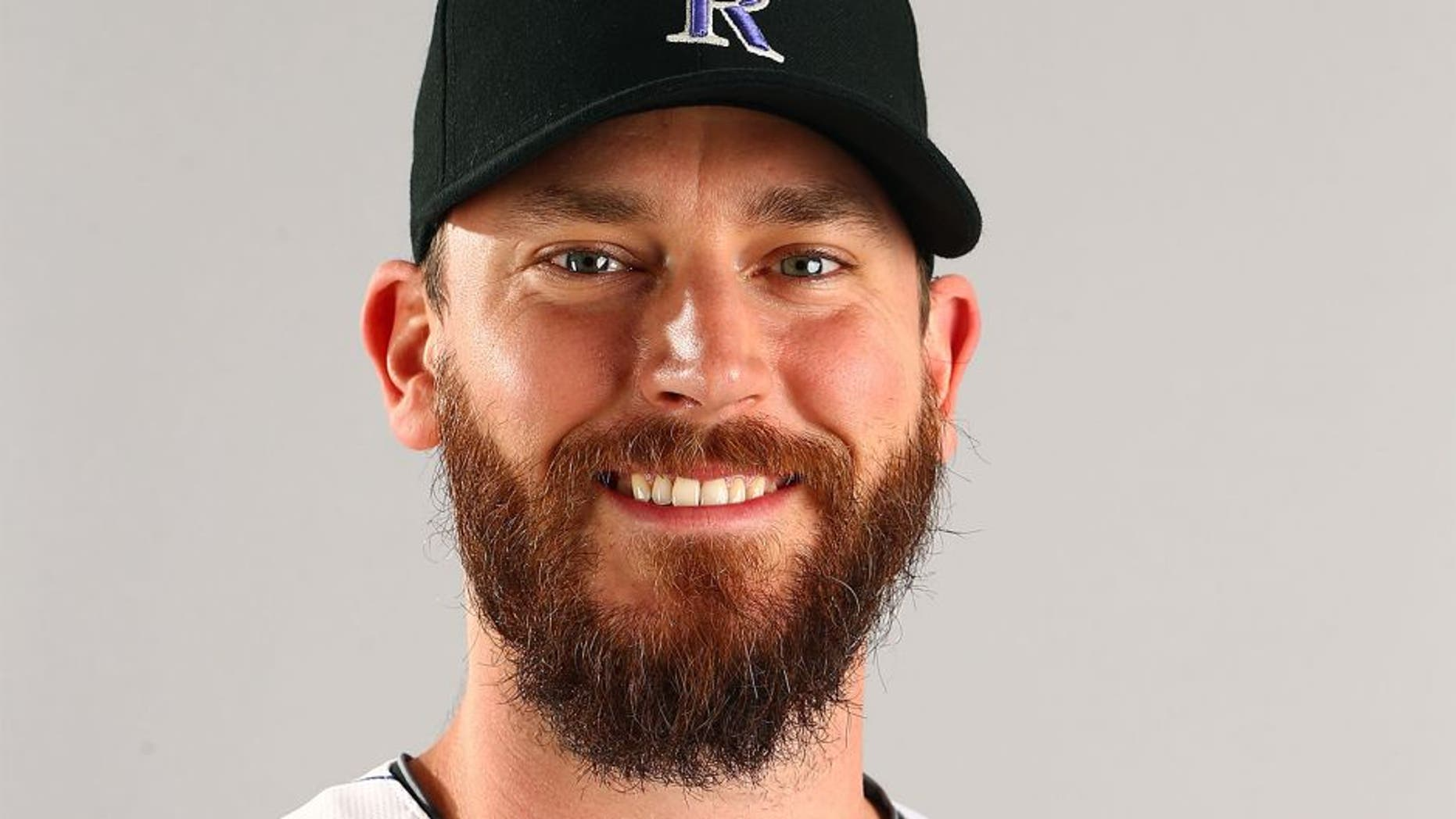 Mar 1, 2015; Scottsdale, AZ, USA; Colorado Rockies pitcher John Axford poses for a portrait during photo day at Salt River Fields. Mandatory Credit: Mark J. Rebilas-USA TODAY Sports