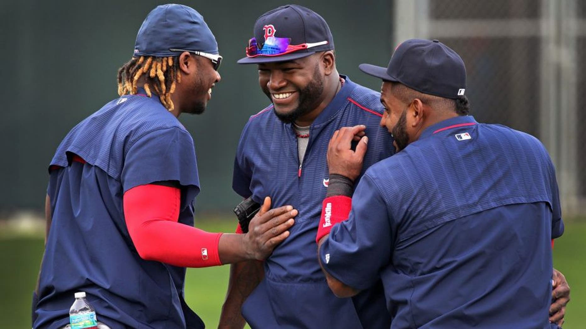 FORT MYERS, FL - FEBRUARY 27: The three amigos Boston Red Sox outfielder Hanley Ramirez, Red Sox designated hitter David Ortiz, and Red Sox third baseman Pablo Sandoval share a laugh during the morning stretching. (Photo by Barry Chin/The Boston Globe via Getty Images)