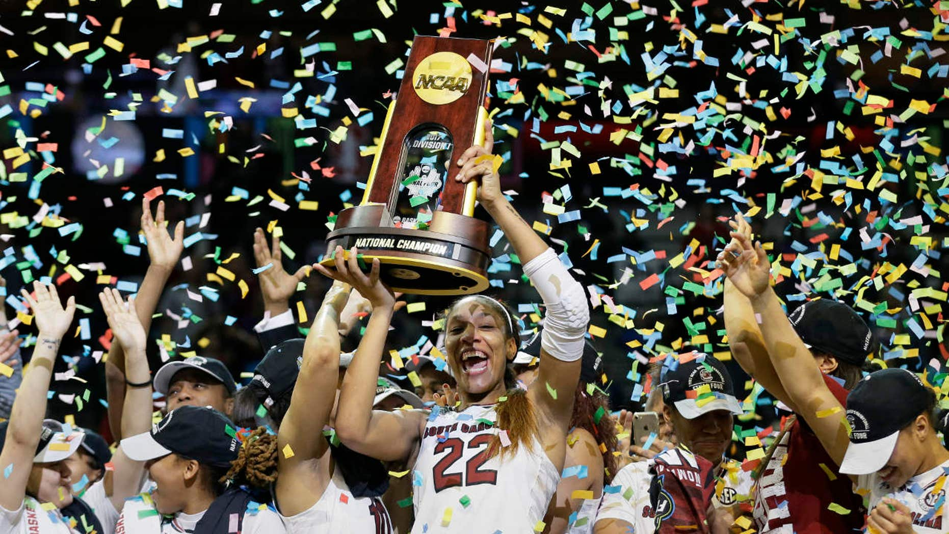 South Carolina forward A'ja Wilson (22) holds the trophy as she and her teammates celebrate a win over Mississippi State in the final of NCAA women's Final Four college basketball tournament, Sunday, April 2, 2017, in Dallas.