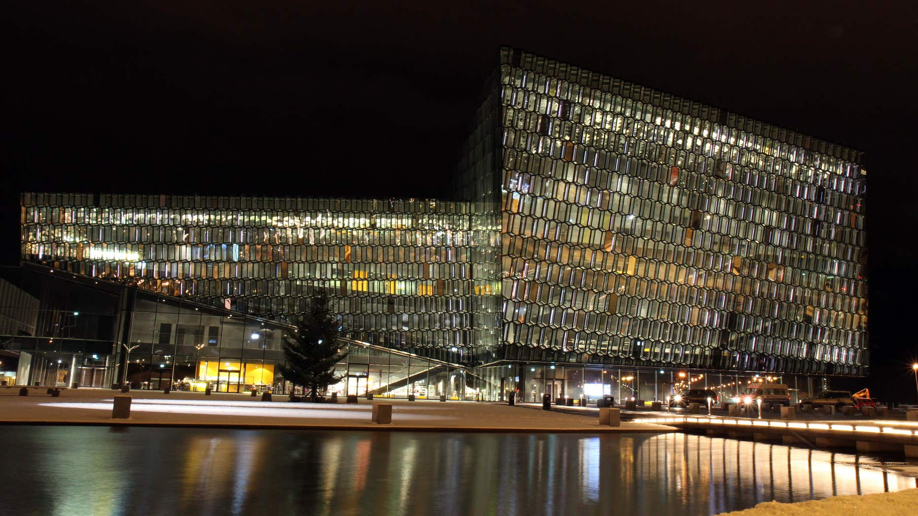 FILE - This Dec. 1, 2011, file photo shows an exterior night view of the Harpa concert hall and conference center in Reykjavik, Iceland.