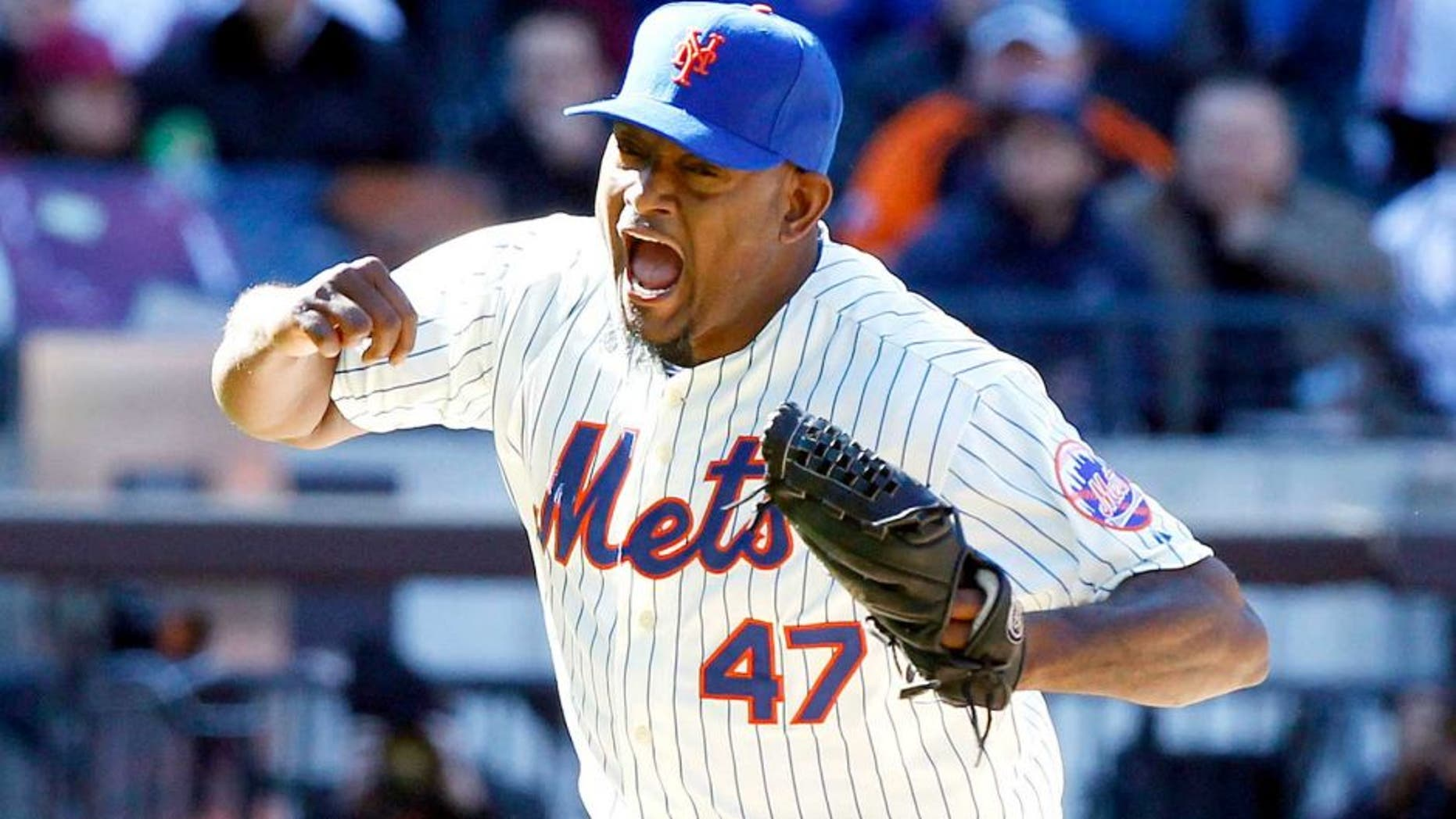 March 31, 2014; New York, NY, USA; New York Mets relief pitcher Jose Valverde (47) reacts as he strikes out Washington Nationals third baseman Ryan Zimmerman (not pictured) with the bases loaded to end the 7th inning of an opening day baseball game at Citi Field. Mandatory Credit: William Perlman/THE STAR-LEDGER via USA TODAY Sports