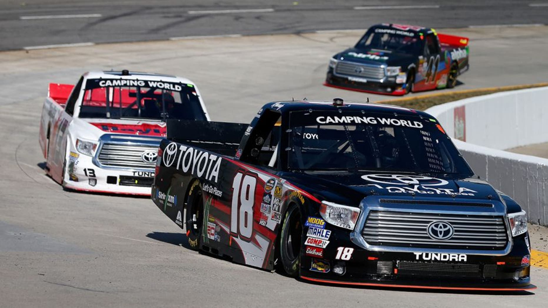 MARTINSVILLE, VA - APRIL 02: Kyle Busch, driver of the #18 Toyota Toyota, leads Cameron Hayley, driver of the #13 Cabinets by Hayley Toyota, and Ben Rhodes, driver of the #41 Alpha Energy Solutions Toyota, during the NASCAR Camping World Truck Series Alpha Energy Solutions 250 at Martinsville Speedway on April 2, 2016 in Martinsville, Virginia. (Photo by Brian Lawdermilk/Getty Images)