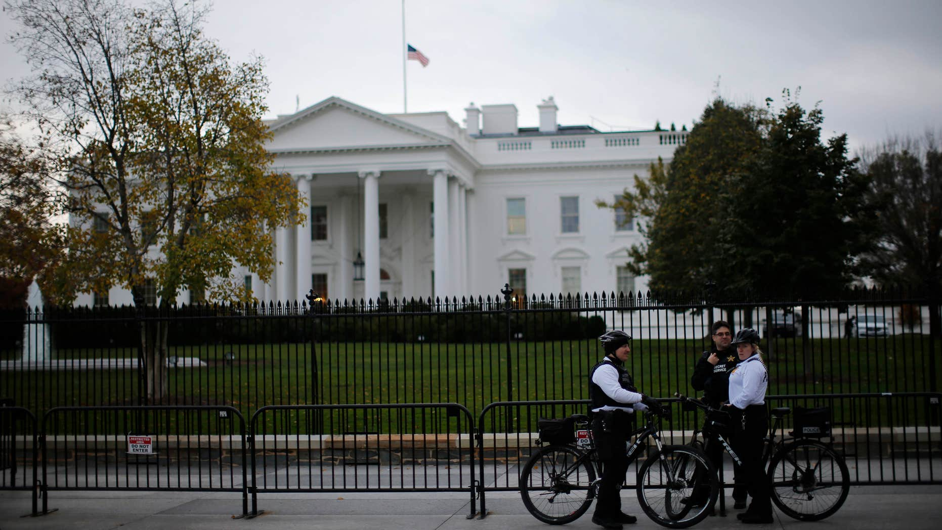 Nov. 17, 2015: Uniformed U.S. Secret Service officers keep watch outside the White House in Washington.