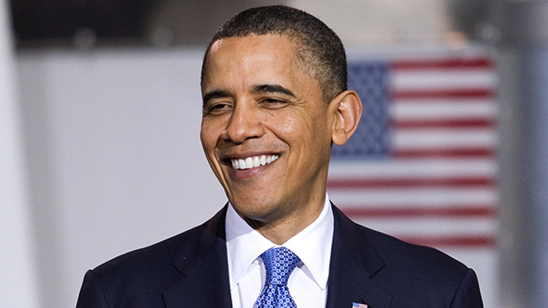 April 1: Obama smiles during an event to promote clean energy vehicles at a UPS facility in Landover, Md.