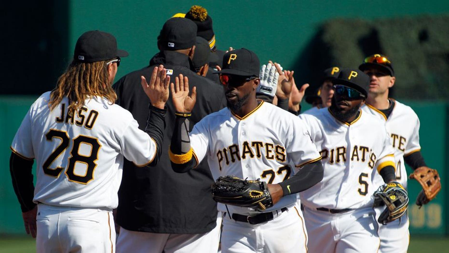 PITTSBURGH, PA - APRIL 03: Andrew McCutchen #22 of the Pittsburgh Pirates celebrates with teammates after defeating the St. Louis Cardinals 4-1 on opening day at PNC Park on April 3, 2016 in Pittsburgh, Pennsylvania. (Photo by Justin K. Aller/Getty Images)