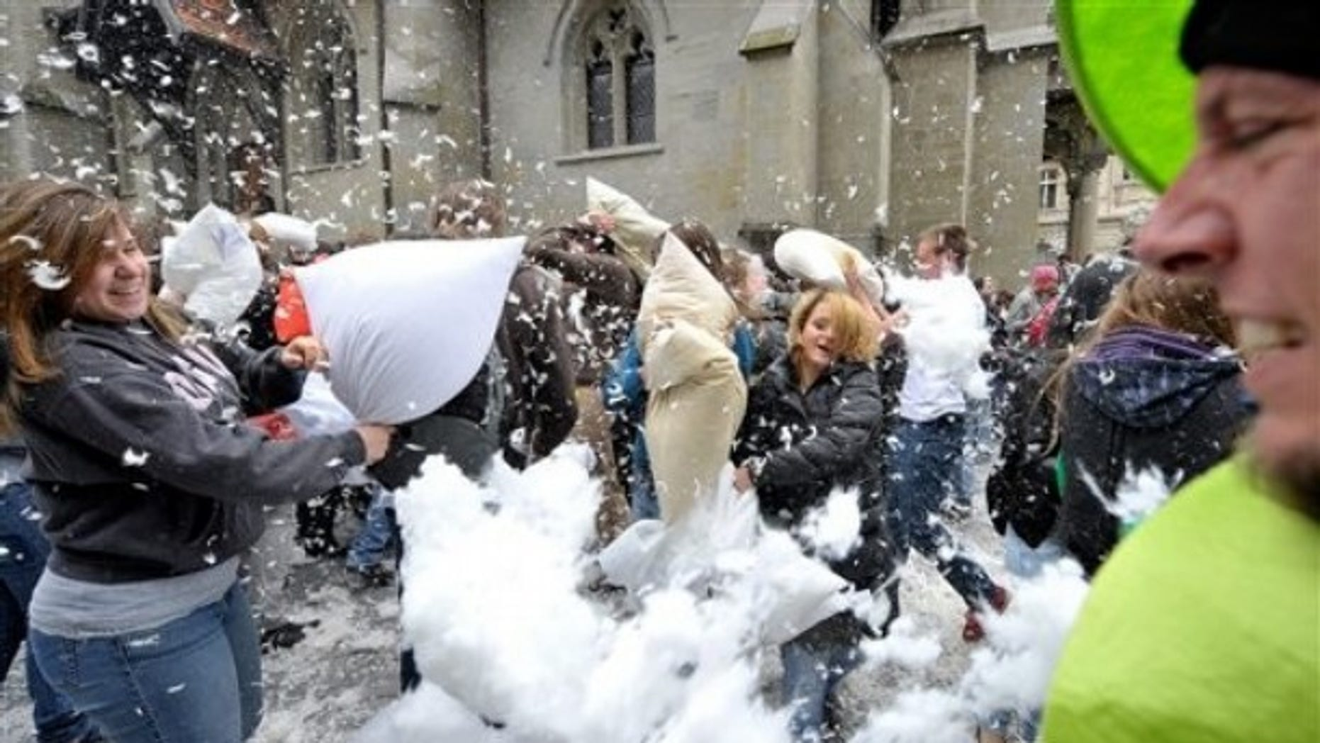 Young poeple take part in an organized pillow fight in Lausanne, Switzerland.