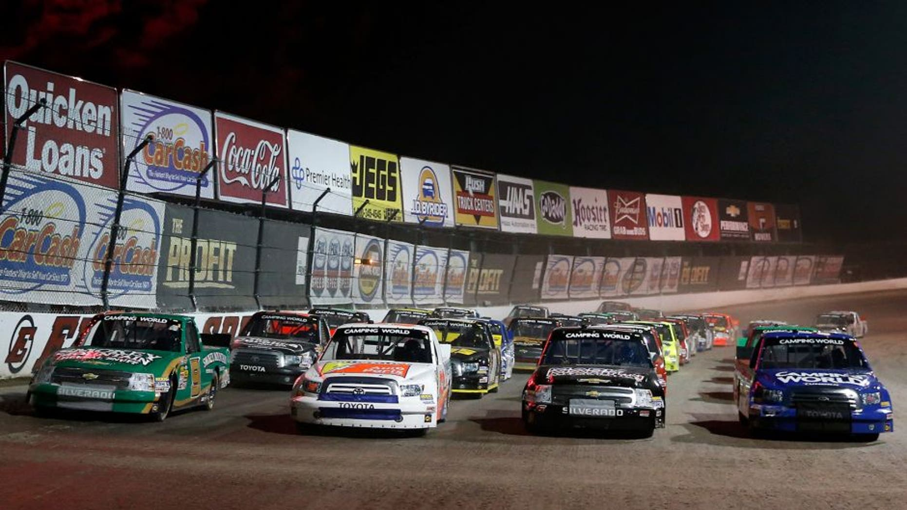 ROSSBURG, OH - JULY 24: Ken Schrader, driver of the #52 Federated Auto Parts Toyota, leads the field as they line up four wide during the NASCAR Camping World Truck Series inaugural CarCash Mudsummer Classic at Eldora Speedway on July 24, 2013 in Rossburg, Ohio. (Photo by Chris Graythen/NASCAR via Getty Images)