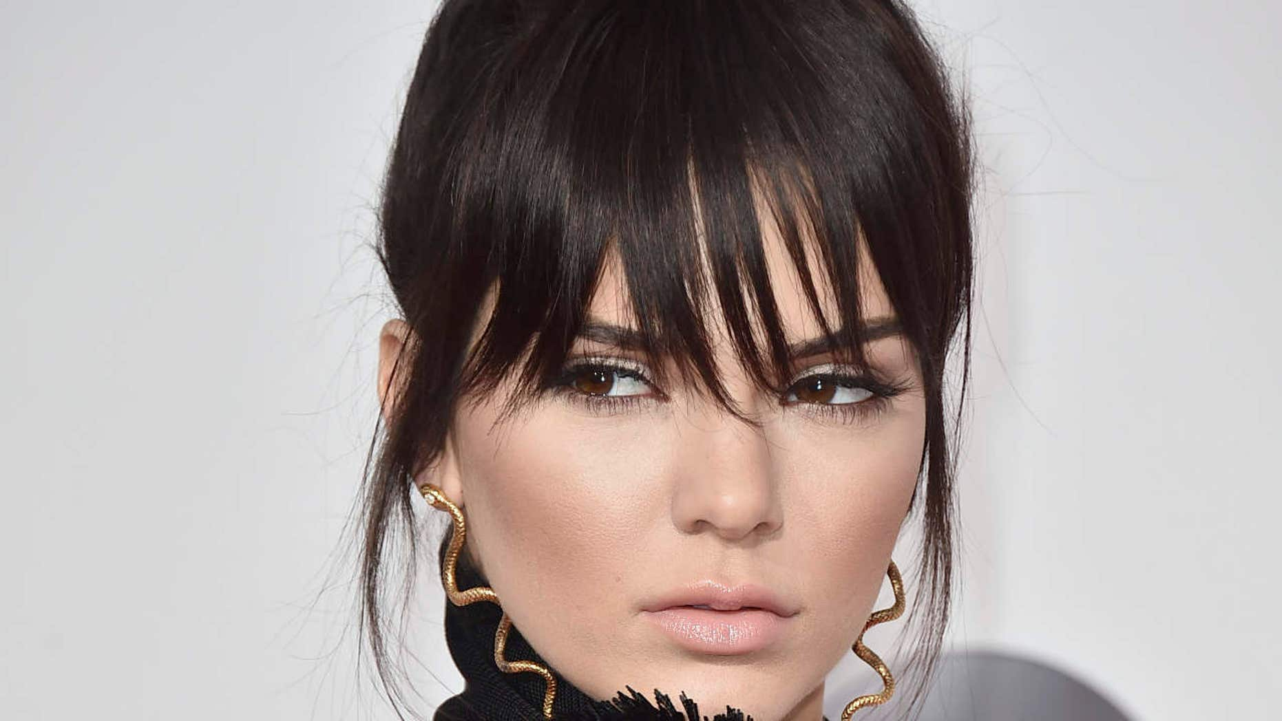 A new Pepsi commercial featuring Kendall Jenner as a soda-wielding protester garnered online backlash as some denounced the advertisement as appropriation for the Black Lives Matter movement.