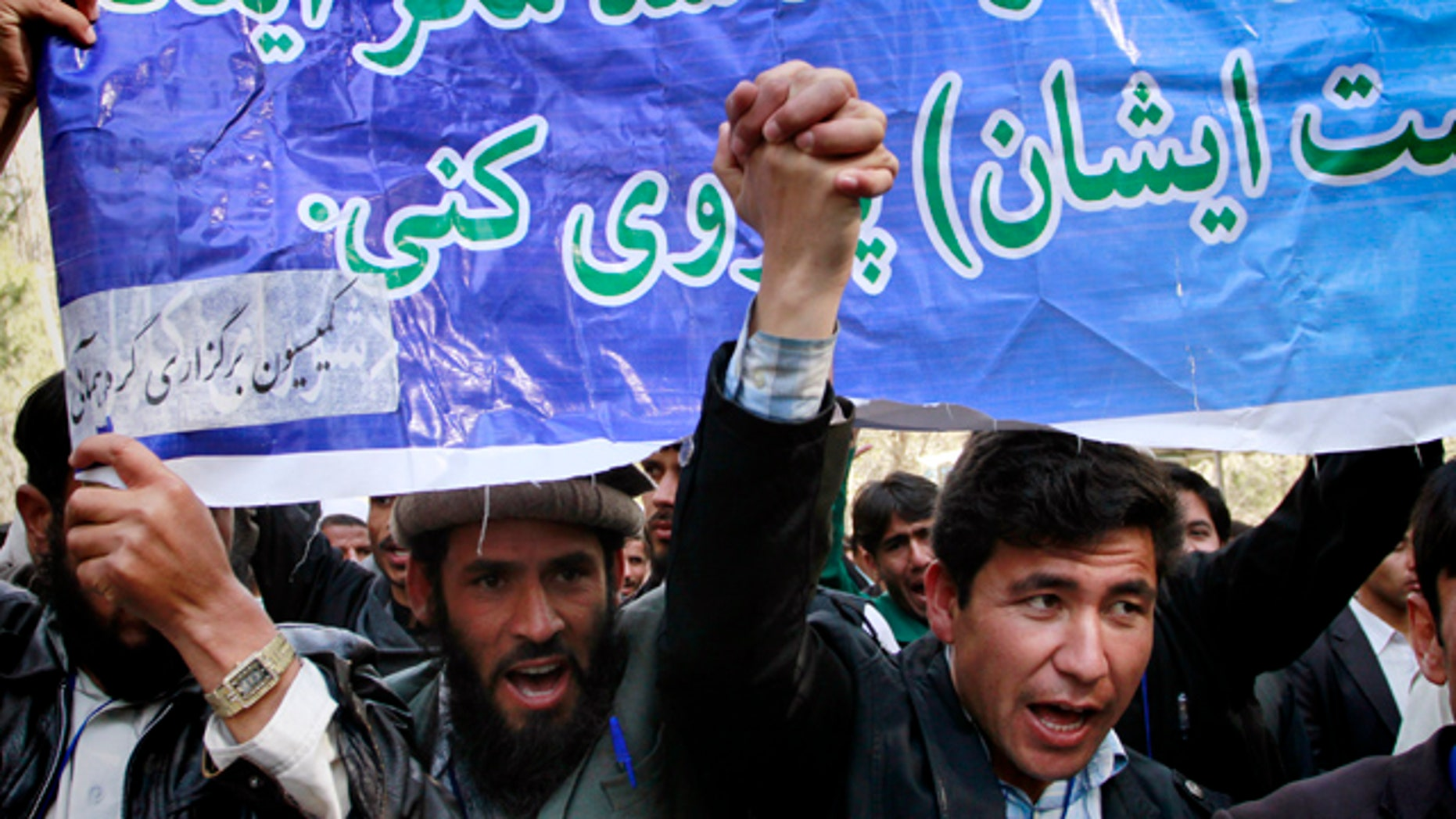 April 5: Afghan students shout anti-U.S. slogans during a demonstration to condemn the burning of a copy of the Muslim holy book by a Florida pastor in Kabul, Afghanistan.