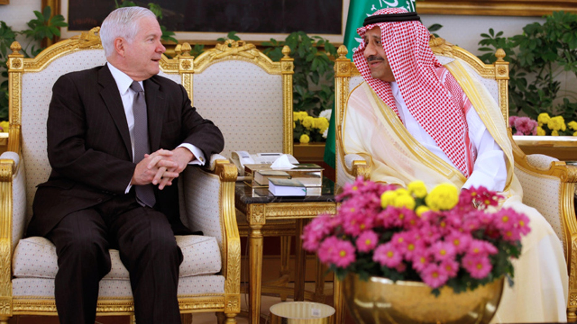 April 6: U.S.  Defense Secretary Robert Gates, left, talks with Saudi Assistant Minister of Defense and Aviation Prince Khalid bin Sultan during a  ceremony in Riyadh, Saudi Arabia.
