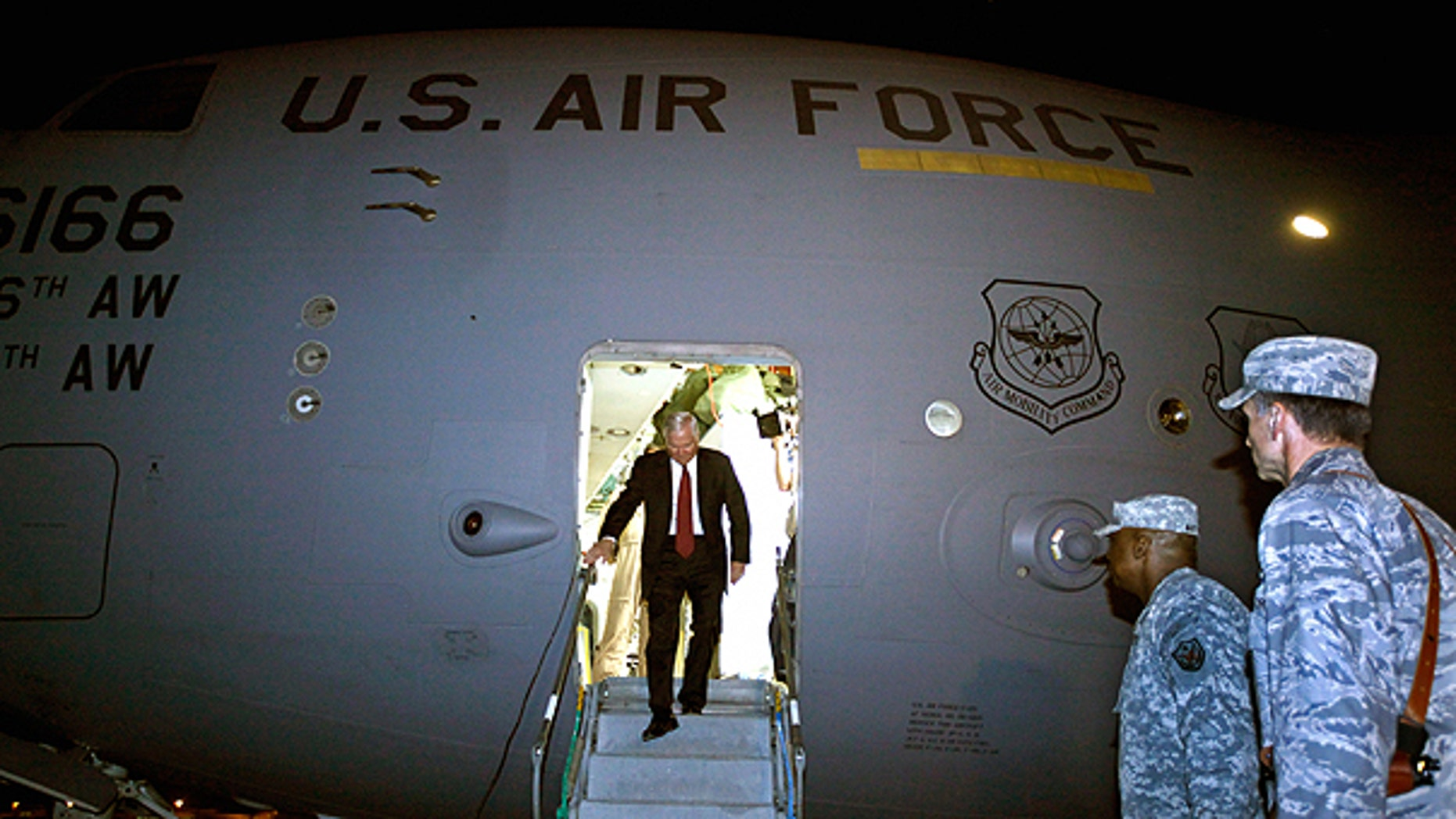 April 6: U.S. Defense Secretary Robert Gates steps off of his C-17 airplane before being met by U.S. Army Gen. Lloyd Austin, center, commanding general of U.S. Forces in Iraq, in Baghdad, Iraq.
