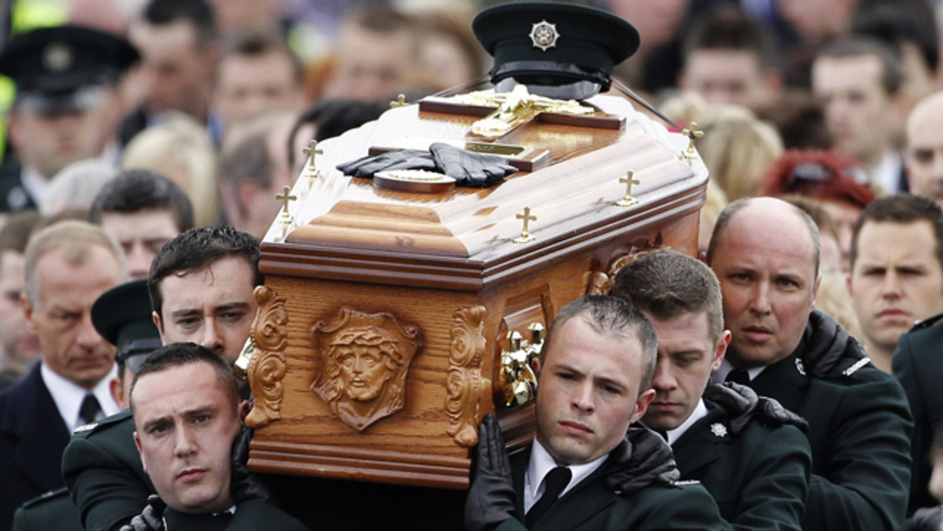 April 6: Police Service of Northern Ireland officers carry the coffin of their colleague Ronan Kerr to a funeral mass at the Church of  Immaculate Conception in Beragh, Northern Ireland.