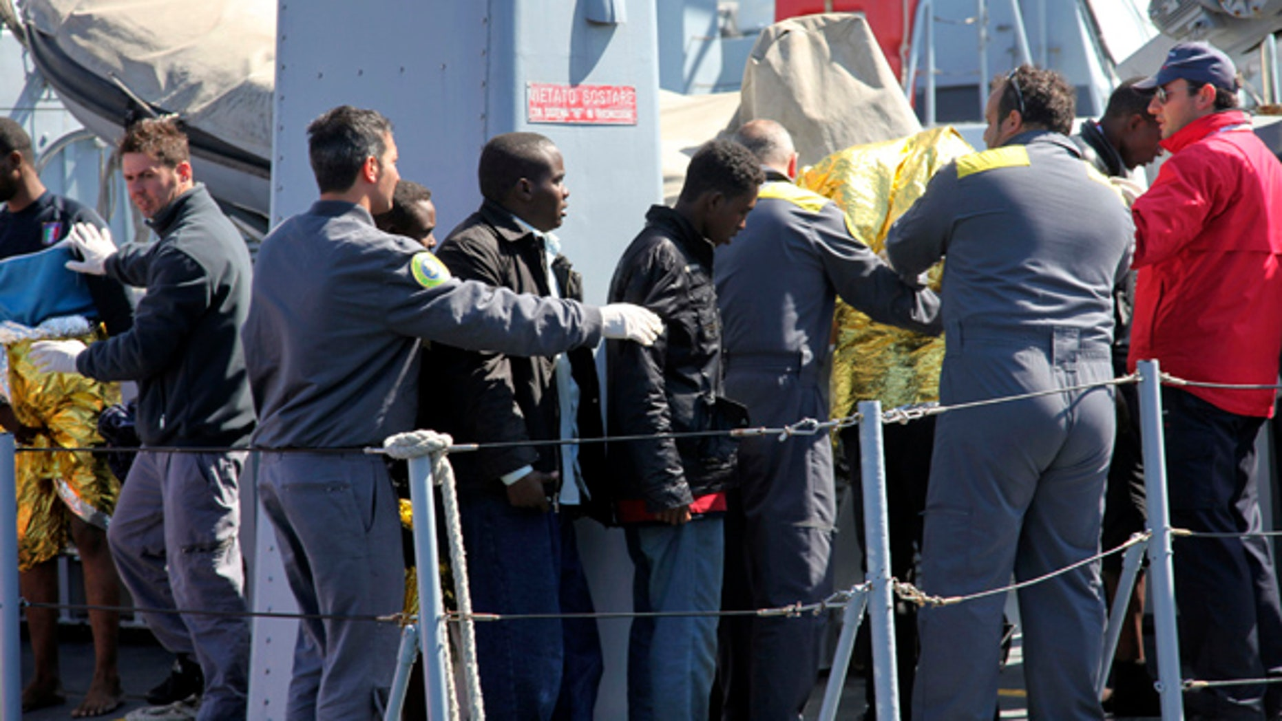 April 6: Survivors receive assistance upon their arrival in Lampedusa, southern Italy.