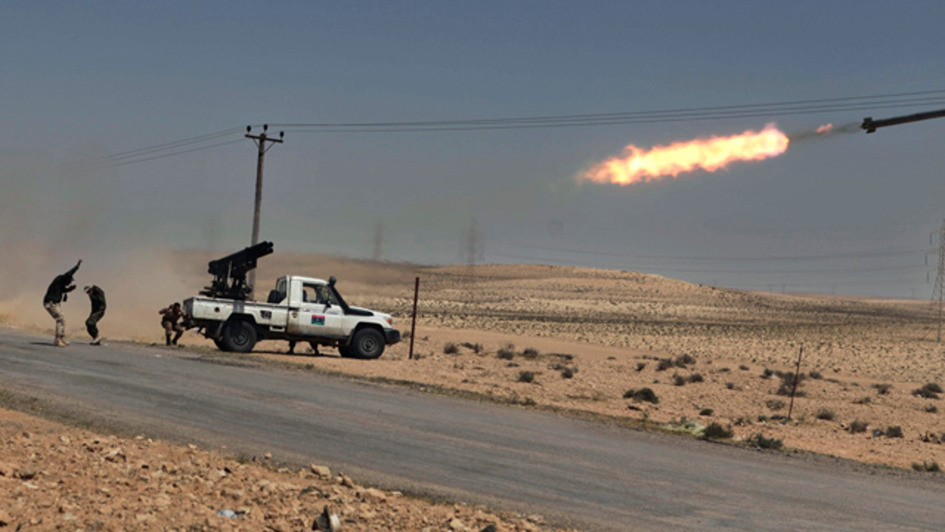 April 5: Libyan rebels shell pro Qaddafi positions just outside Brega, Libya.
