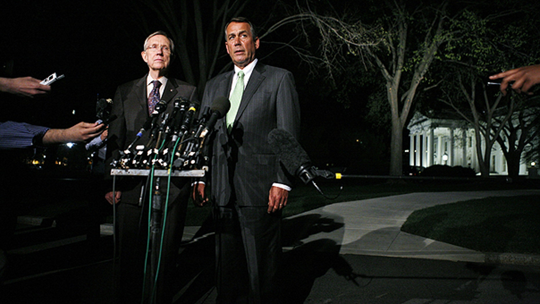 April 6: House Speaker John Boehner, R-Ohio and Senate Majority Leader Harry Reid, D-Nev., speak to reporters after their meeting at the White House in Washington with President Obama regarding the budget and possible government shutdown.