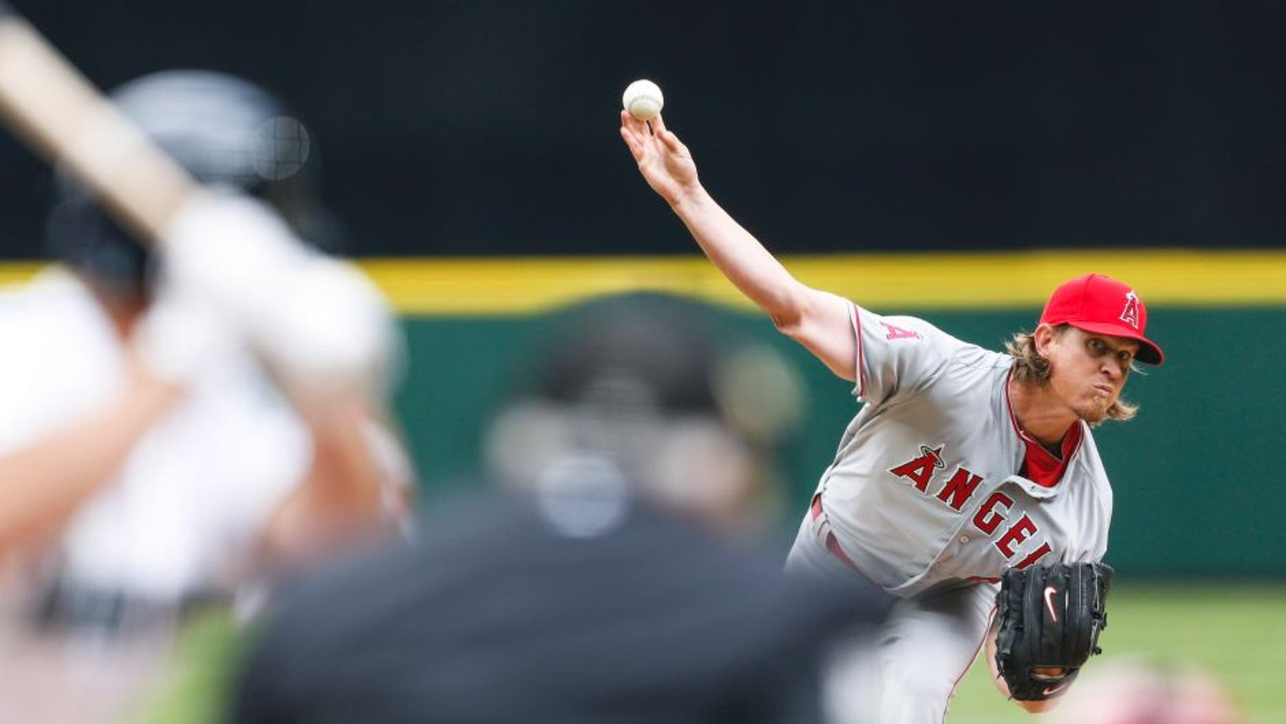 Apr 6, 2015; Seattle, WA, USA; Los Angeles Angels pitcher Jered Weaver (36) throws against the Seattle Mariners during the fourth inning at Safeco Field. Mandatory Credit: Joe Nicholson-USA TODAY Sports