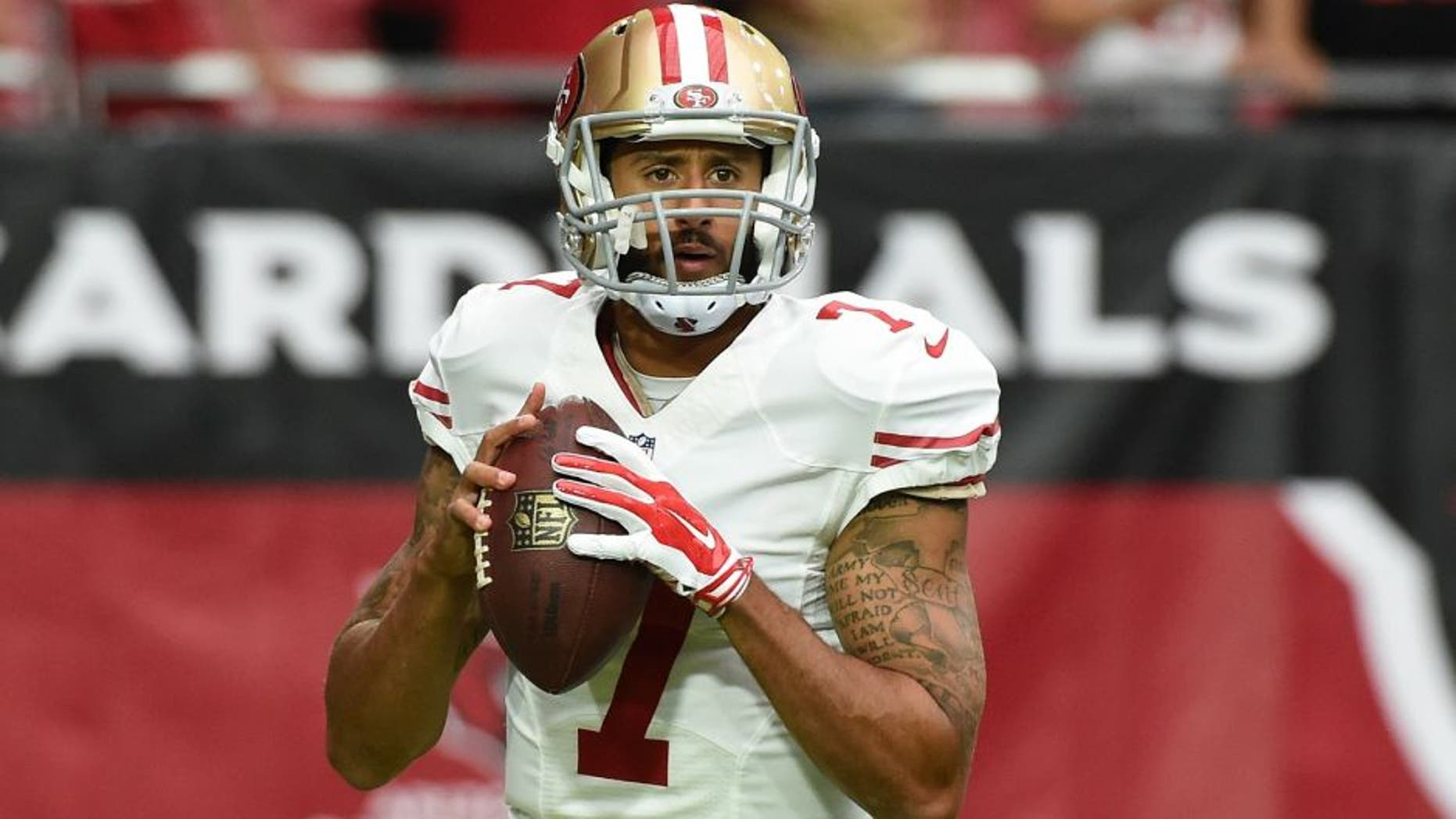 against the San Francisco 49ers at University of Phoenix Stadium on September 27, 2015 in Glendale, Arizona.,GLENDALE, AZ - SEPTEMBER 27: Colin Kaepernick #7 of the San Francisco 49ers prepares for a game against the Arizona Cardinals at University of Phoenix Stadium on September 27, 2015 in Glendale, Arizona. (Photo by Norm Hall/Getty Images)