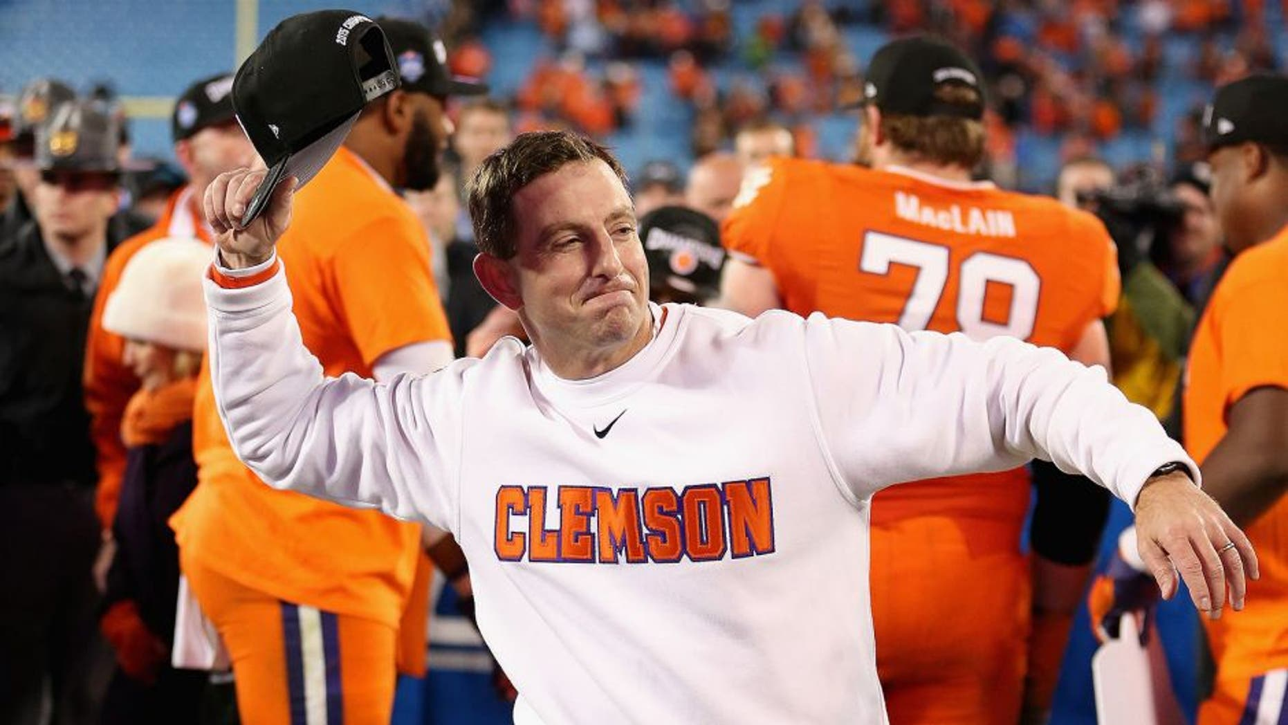CHARLOTTE, NC - DECEMBER 05: Head coach Dabo Swinney of the Clemson Tigers celebrates after defeating the North Carolina Tar Heels 45-37 at the Atlantic Coast Conference Football Championship at Bank of America Stadium on December 5, 2015 in Charlotte, North Carolina. (Photo by Streeter Lecka/Getty Images)