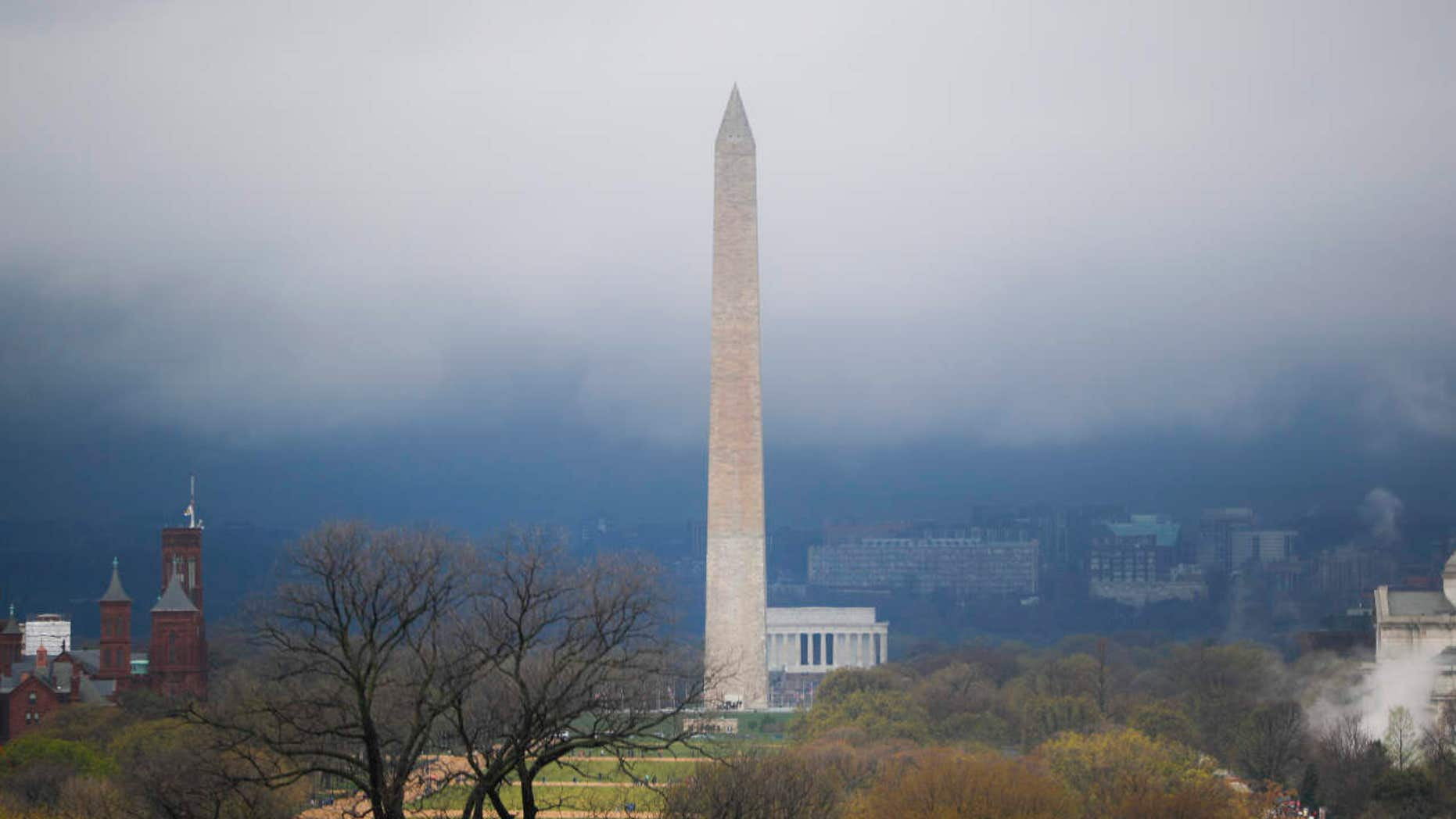 Storm clouds form around the Washington Monument and Lincoln Memorial in Washington, Thursday, April 6, 2017.