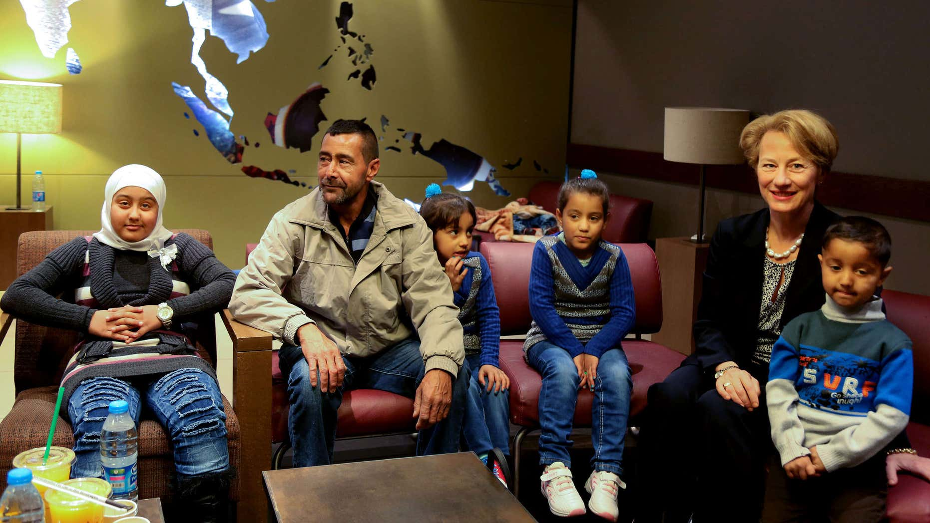 April 6, 2016: U.S. Ambassador to Jordan Alice Wells, right, meets with Syrian refugee Ahmad al-Abboud, center, and his family at the International Airport of Amman, Jordan.