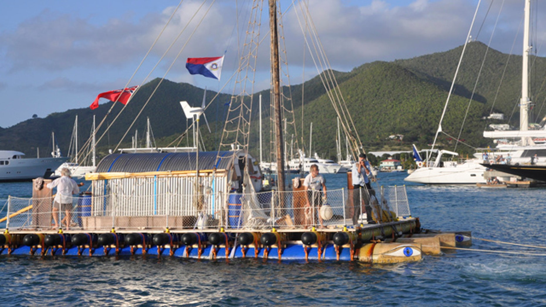 April 6: Eighty five-year-old British sailor Anthony Smith, right, captains the An-Tiki, a 40-foot sail-powered raft, as he and crew complete their roughly two month, transatlantic voyage, arriving into Philipsburg, St. Maarten.